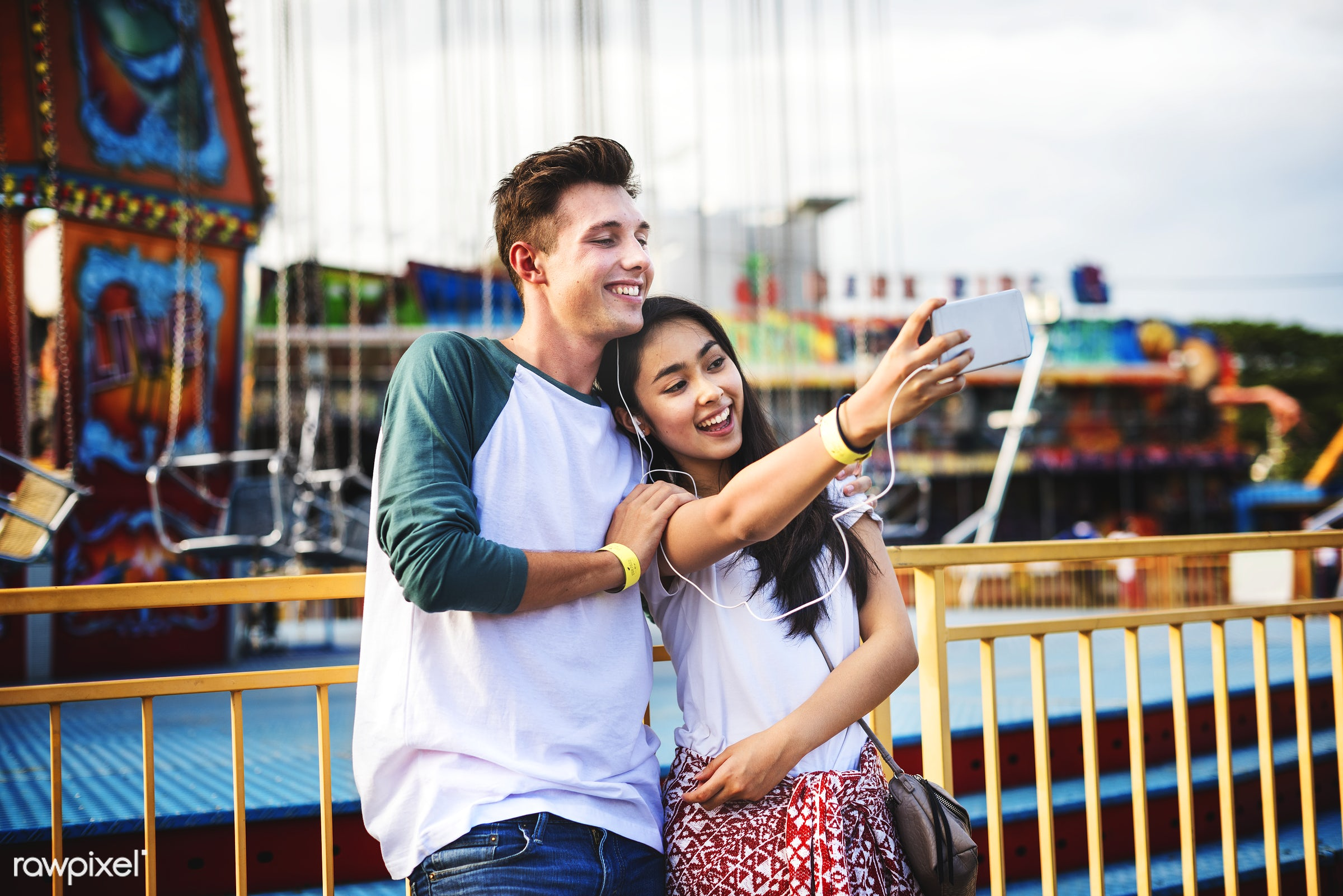 Cute couple taking a selfie at an amusement park - amusement park, selfie, activity, american, asian, black hair, carefree,...