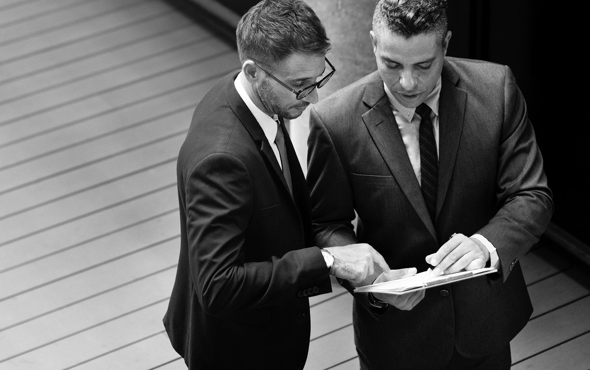 Businessmen talking together grayscale
