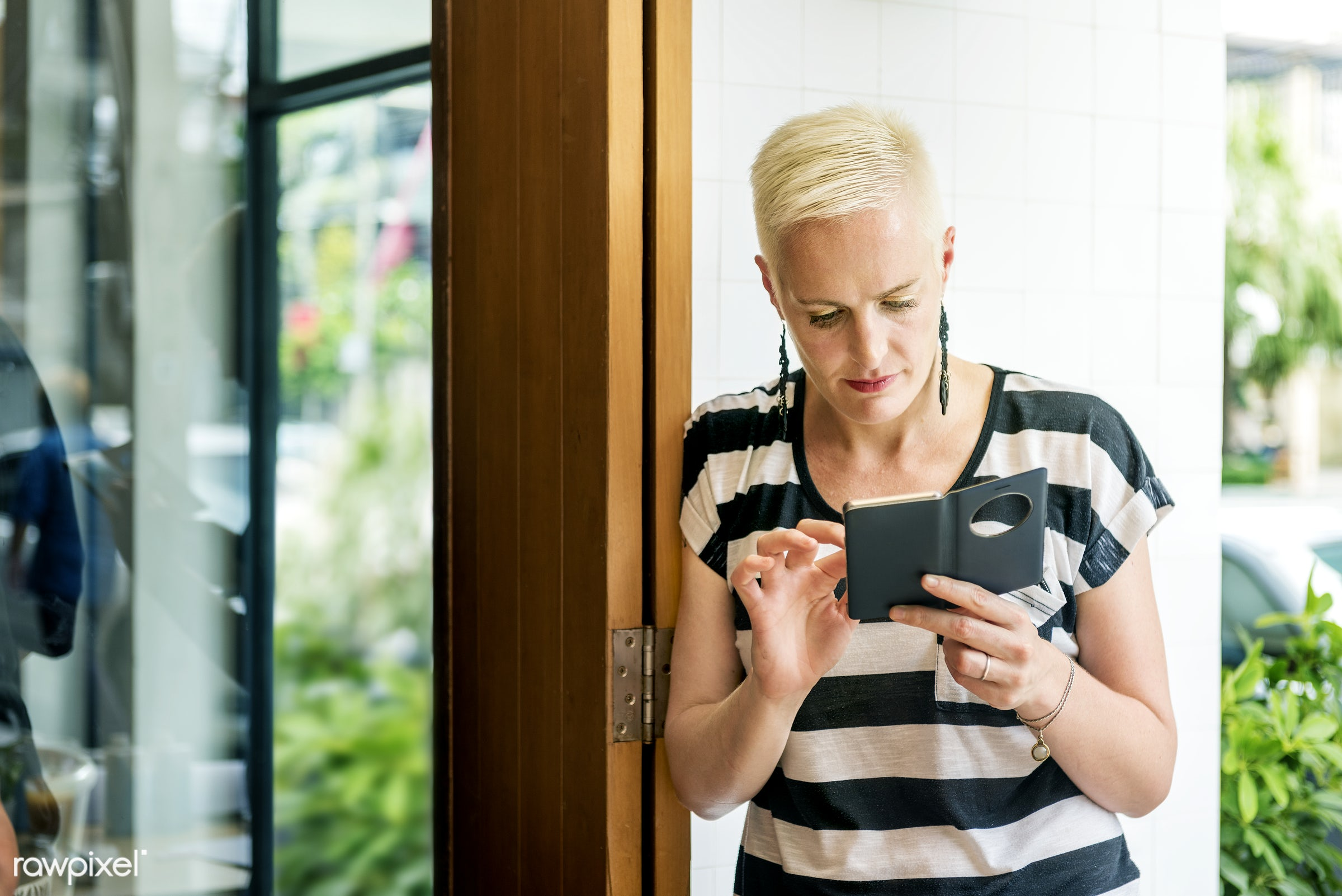 Woman texting on her phone - calm, casual, chilling, connection, content, device, electronic, enjoyment, entertainment,...
