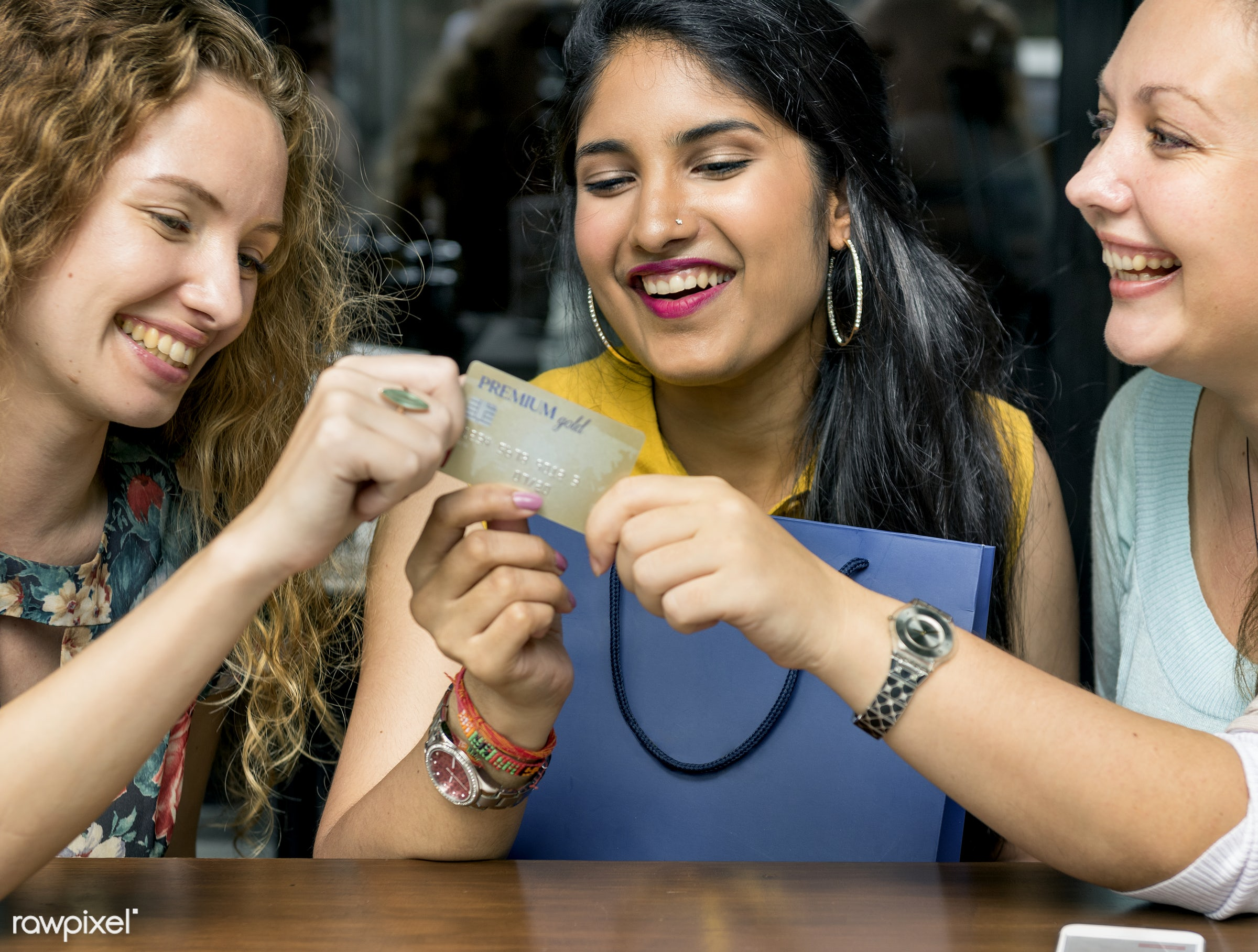 Women shopping with a credit card - card, credit, indian, accessories, bag, beautiful, buyers, cheerful, communication,...
