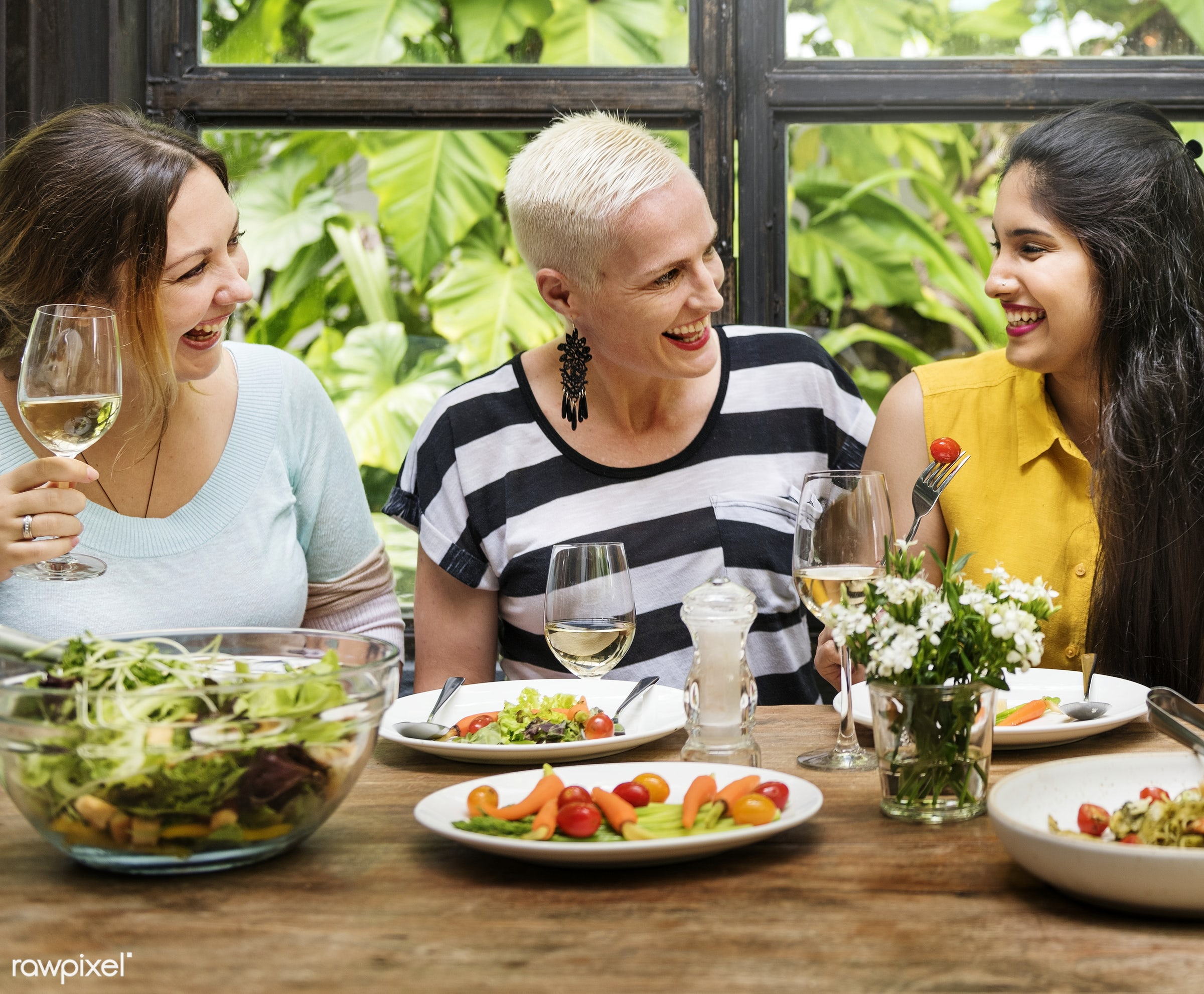 Women at a dinner party - dining, restaurant, adult, african descent, bonding, bright, brunch, cafe, casual, celebration,...