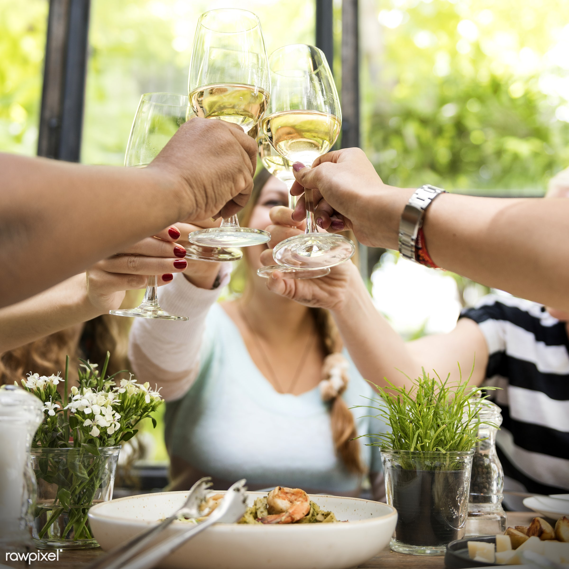 Women celebrating with wine - asian, brunch, caucasian, celebrating, celebration, champagne, cheerful, cheering, cheers,...