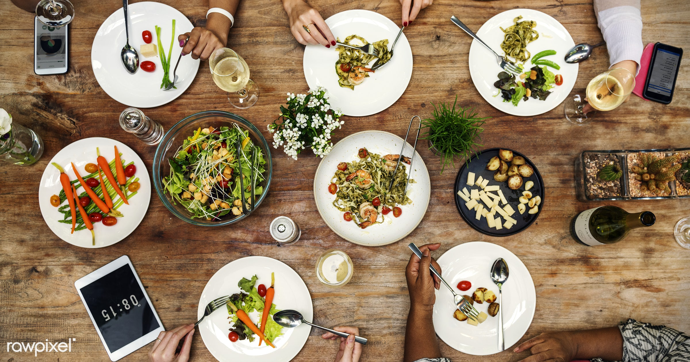 Woman having a dinner party - food, eating, dinner, salad, meal, brunch, summer, table, lunch, share, restaurant, fun,...