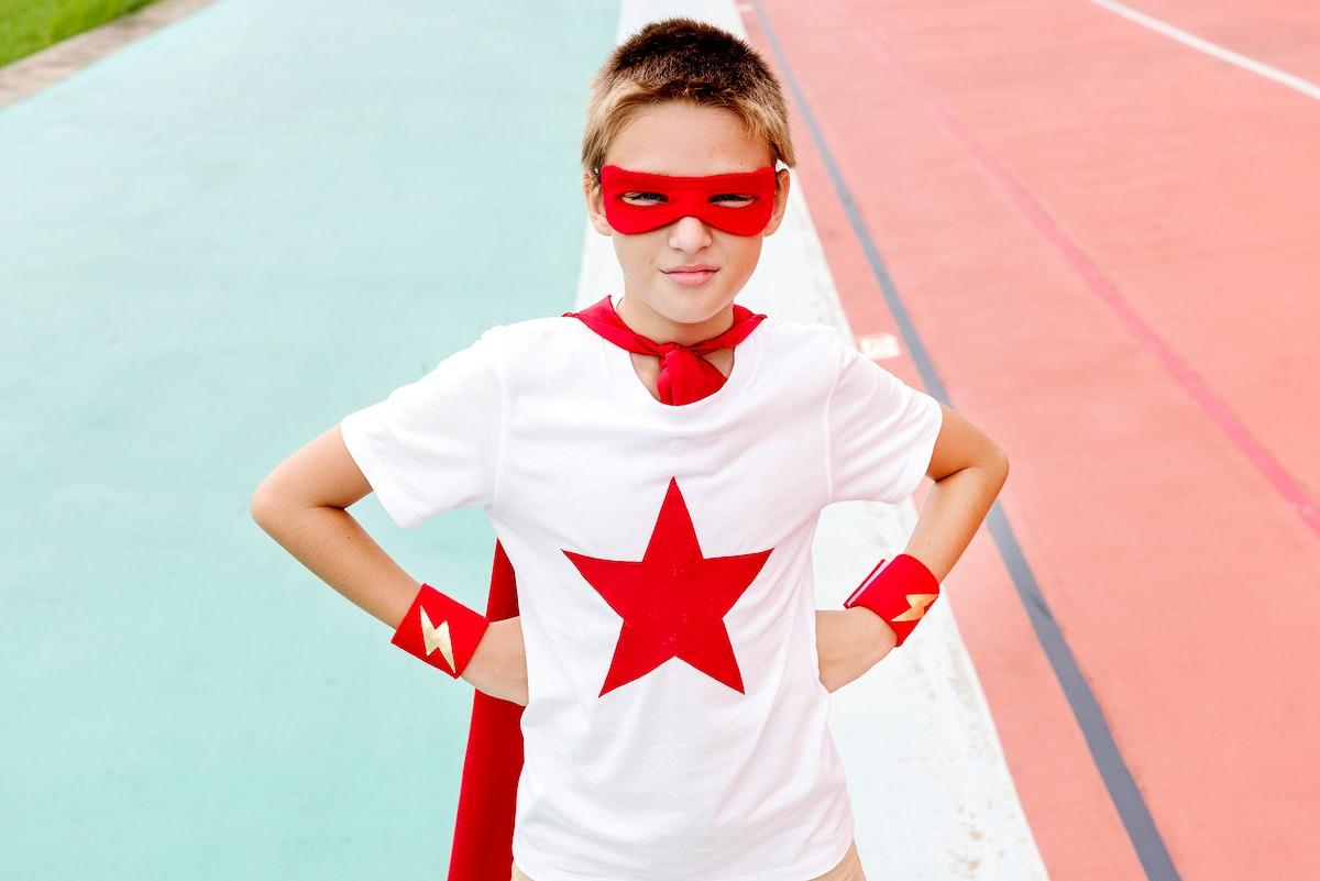 A boy playing superhero