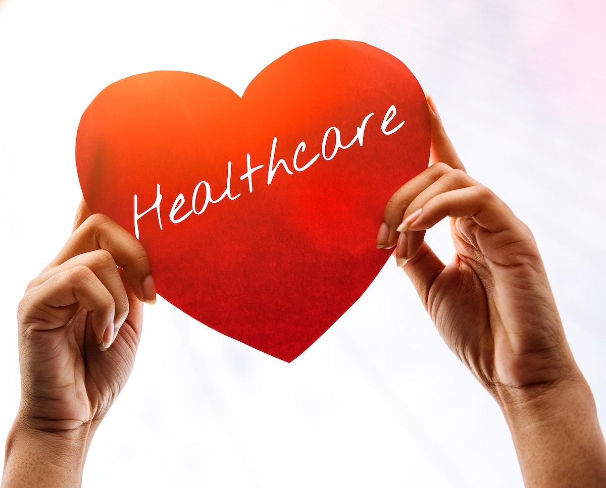 Closeup of hands holding paper heart