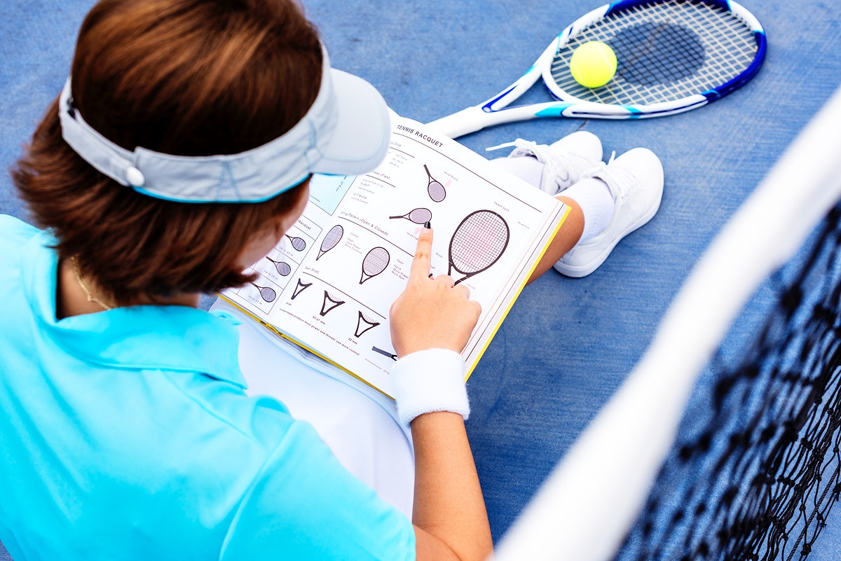 Tennis player reading a manual