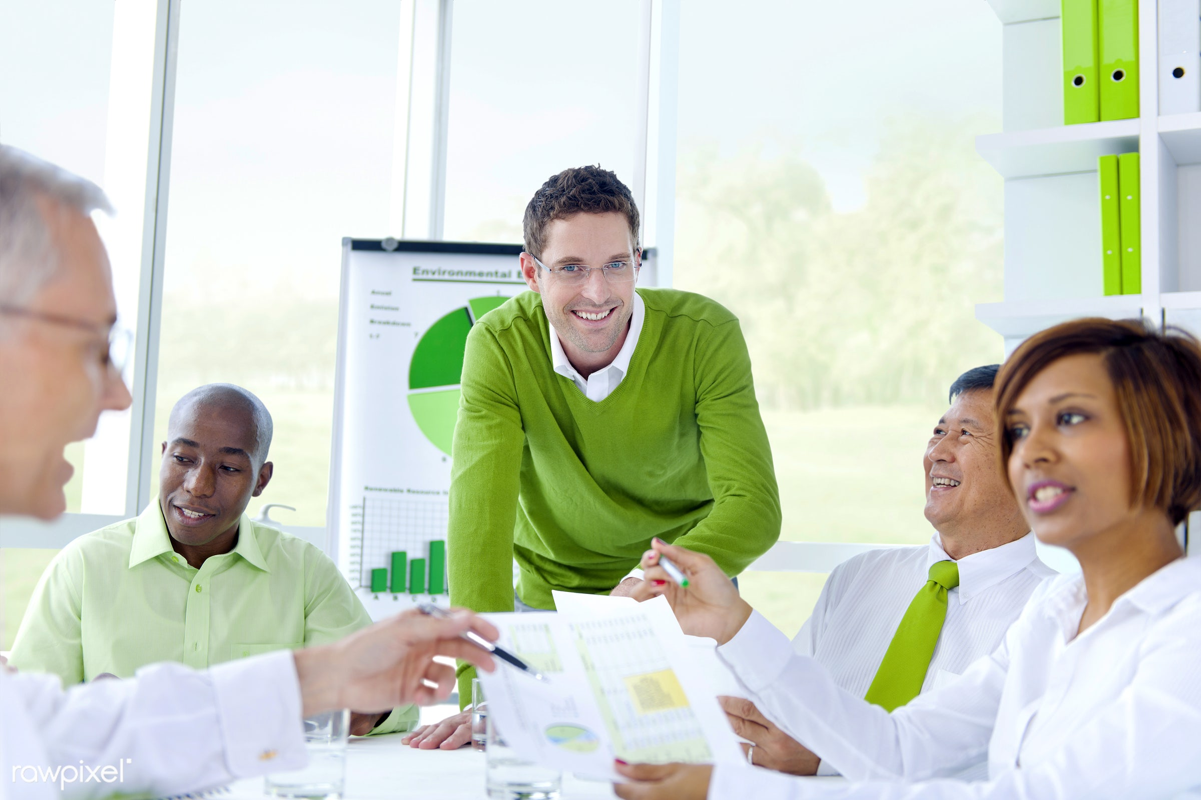 Business people in a corporate green office - assistant, adult, african descent, asian ethnicity, brainstorming, built...