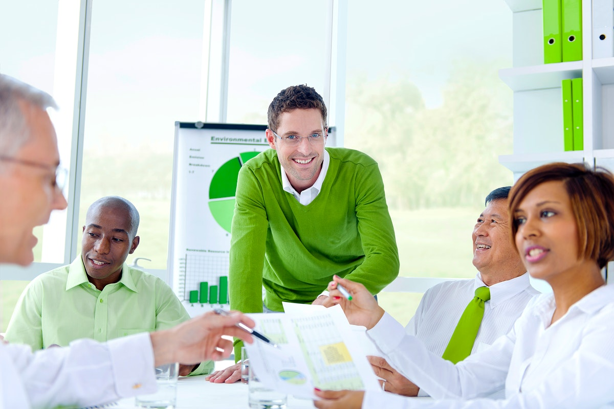 Business people in a corporate green office