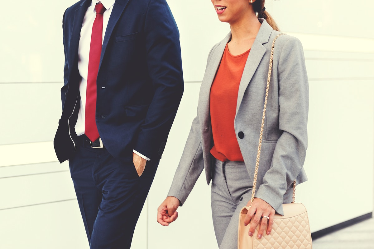 Closeup of business people walking together