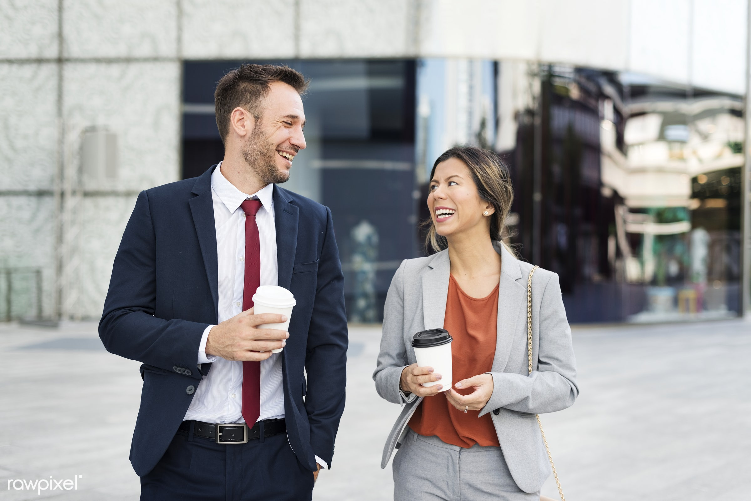 Business man and woman colleagues having a coffee break talking together - business, businessman, corporate, woman,...