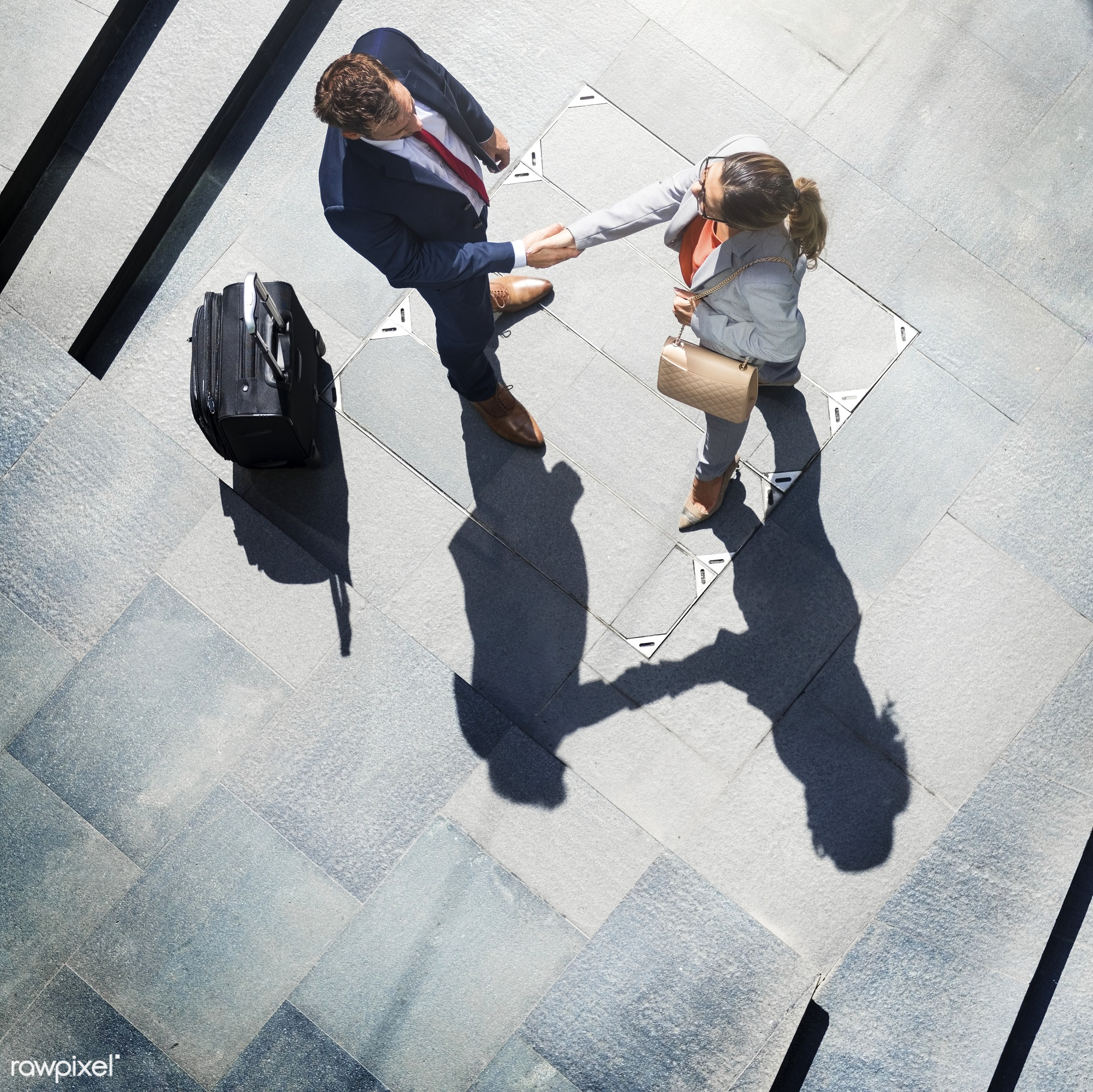 Caucasian man and woman colleagues business shoot - handshake, vision, aerial view, agreement, business, business people,...