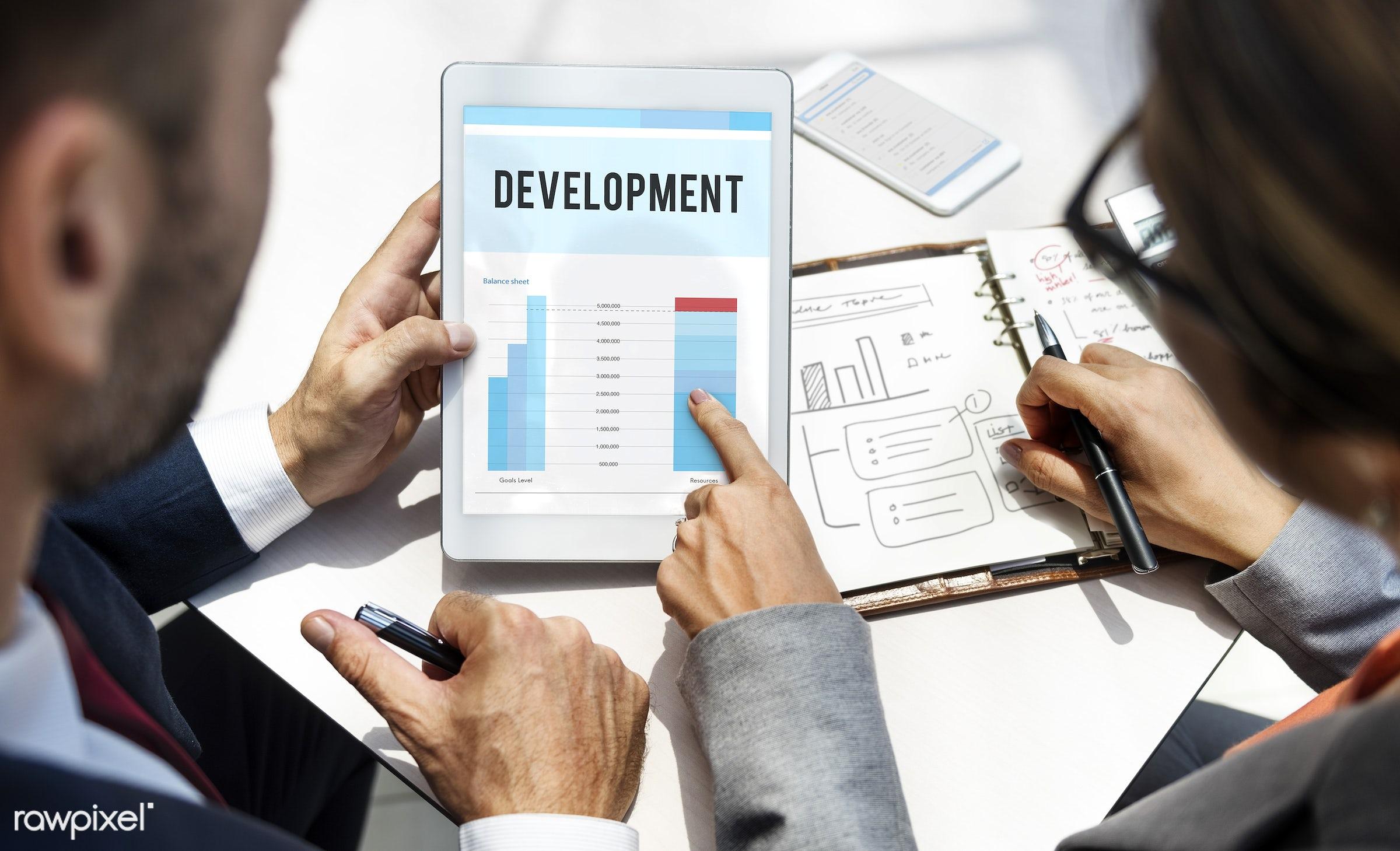 achievement, aim, analysis, businessman, businessmen, businesswoman, businesswomen, calculator, cellphone, data, develop,...