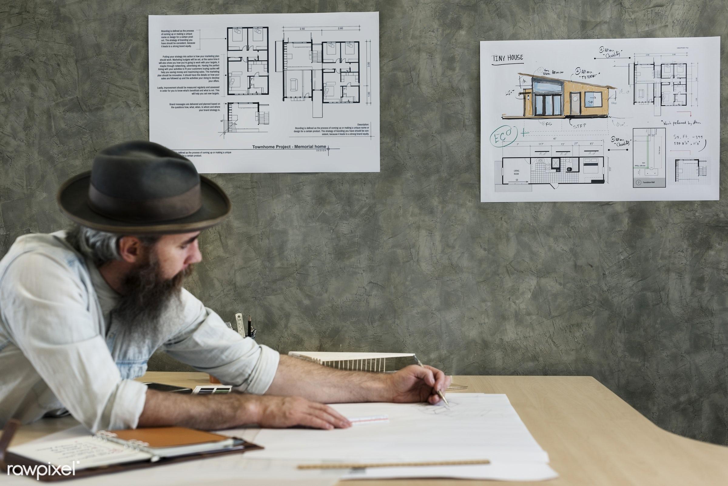 Architect working in a design studio - designer, model, structure, architect, architecture, blueprint, brainstorming, color...