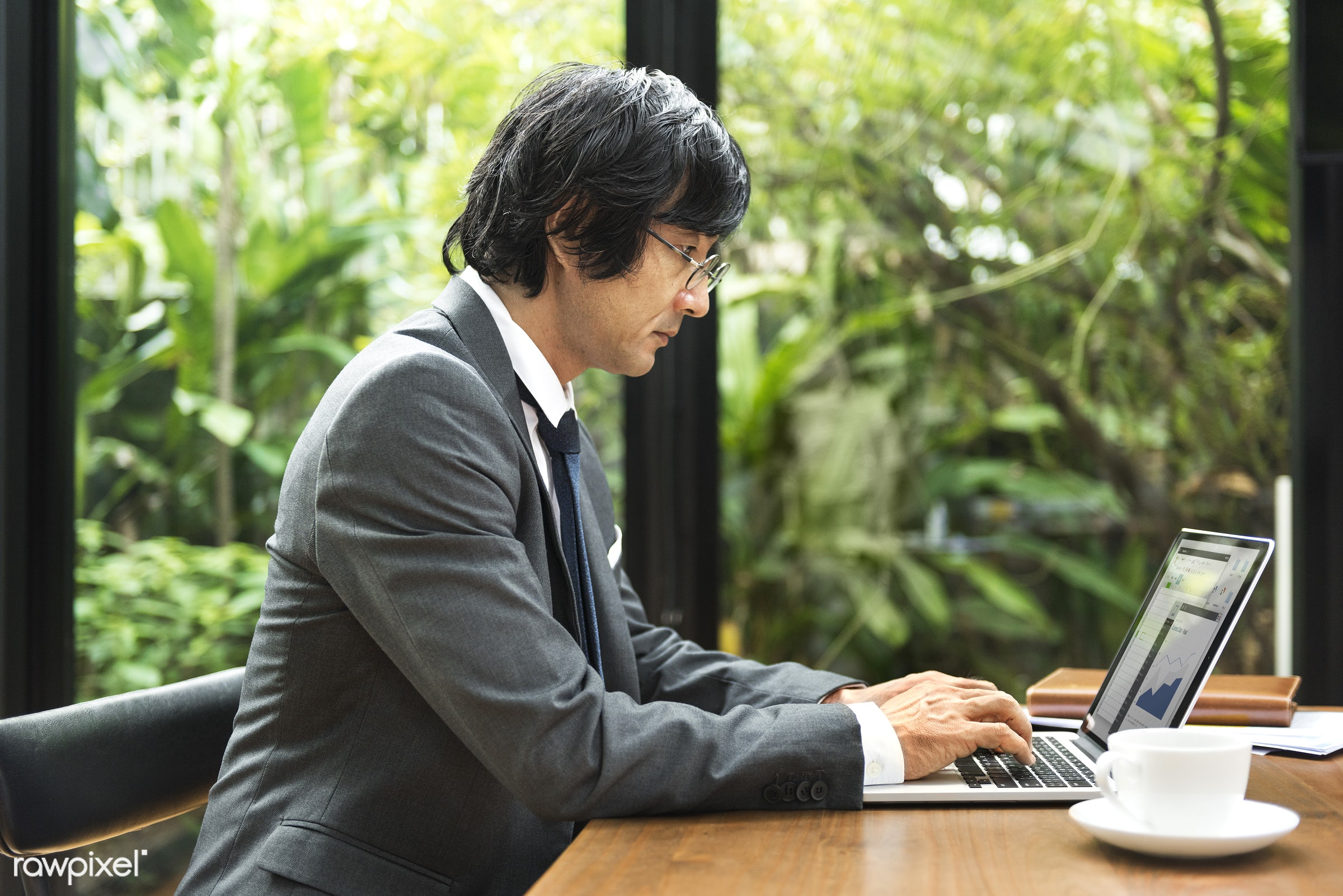 Japanese man working on a laptop - asian ethnicity, brainstorming, business, businessman, coffee, collaboration, colleagues...