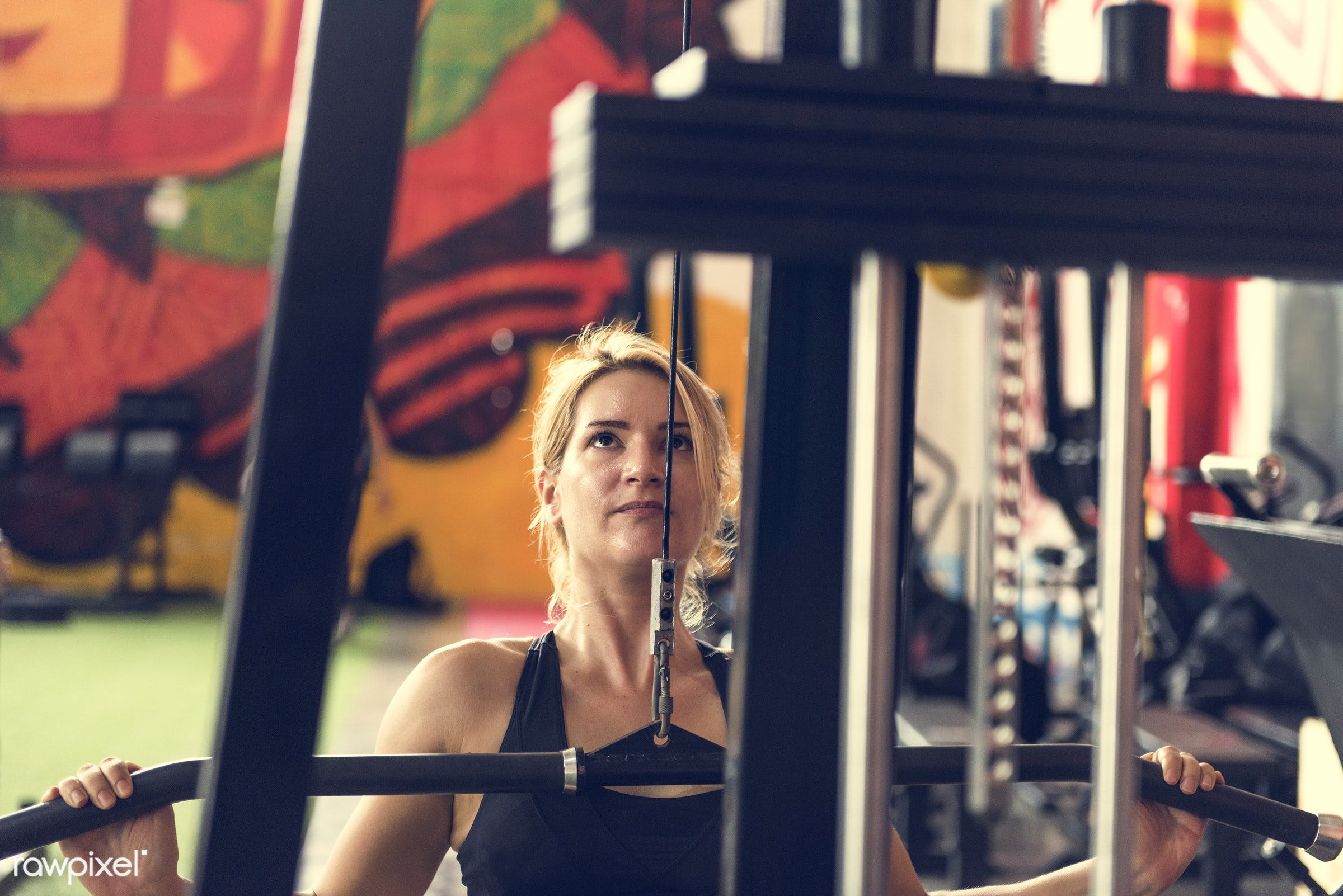 At the gym - active, activity, athlete, athletic, attractive, body, caucasian, concentration, equipment, exercise, female,...