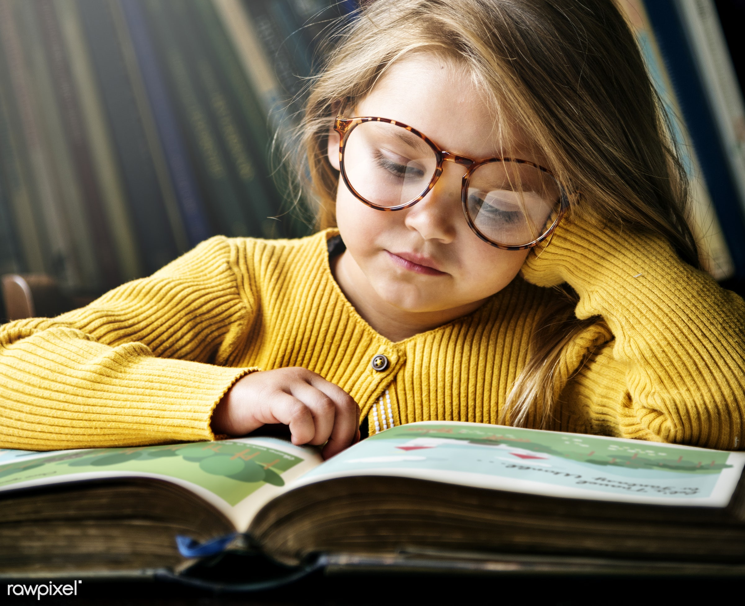 Cute and adorable little girl with glasses reading a story - art, beautiful, book, bookstore, caucasian, child, childhood,...