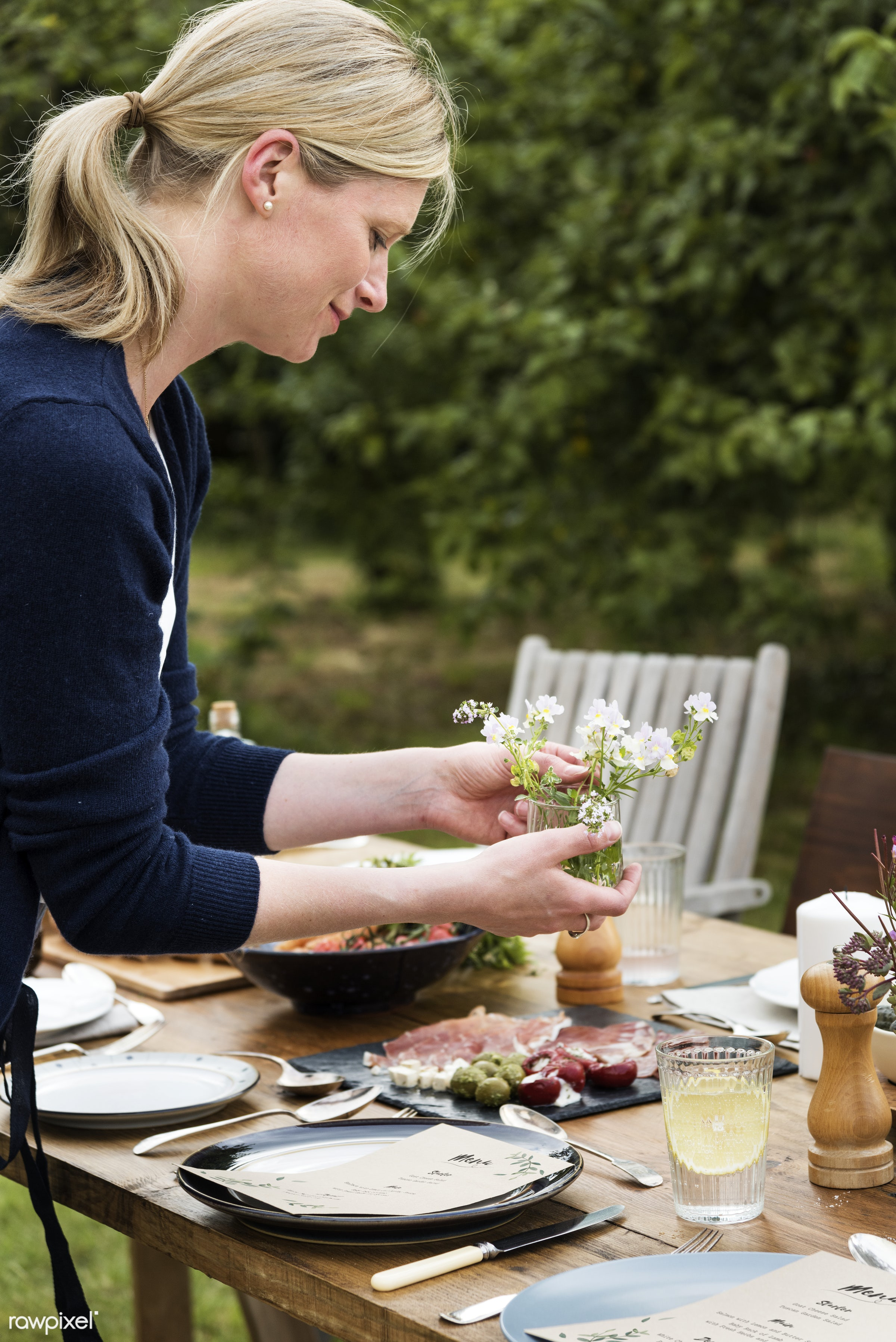 Woman preparing the dinner table - accurate, adult, advance, background, beautiful, blonde, creative, decorating,...