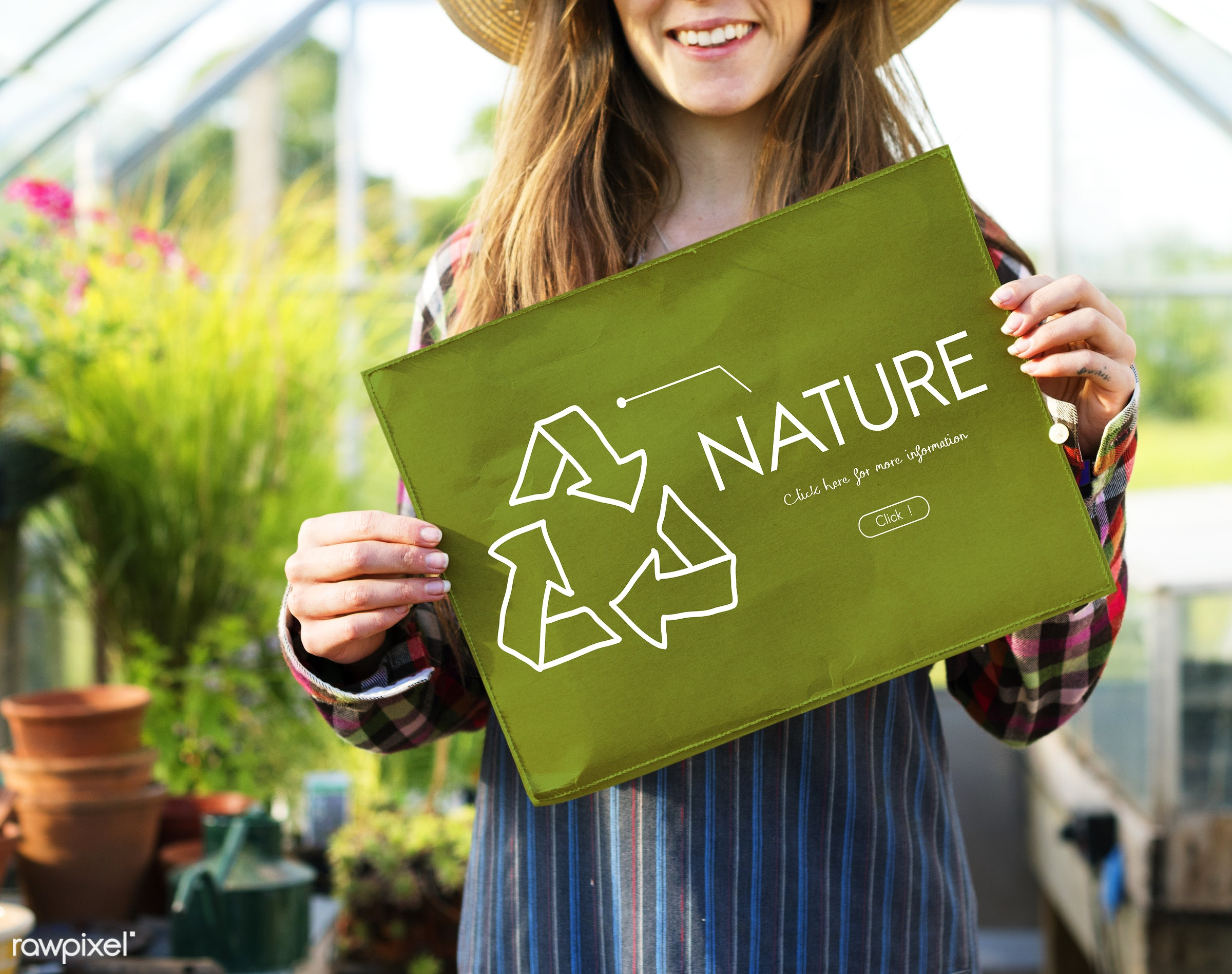 Young woman showing nature poster - eco, bio, recycle, adult, alternative, countryside, dark blonde, earth, ecology,...