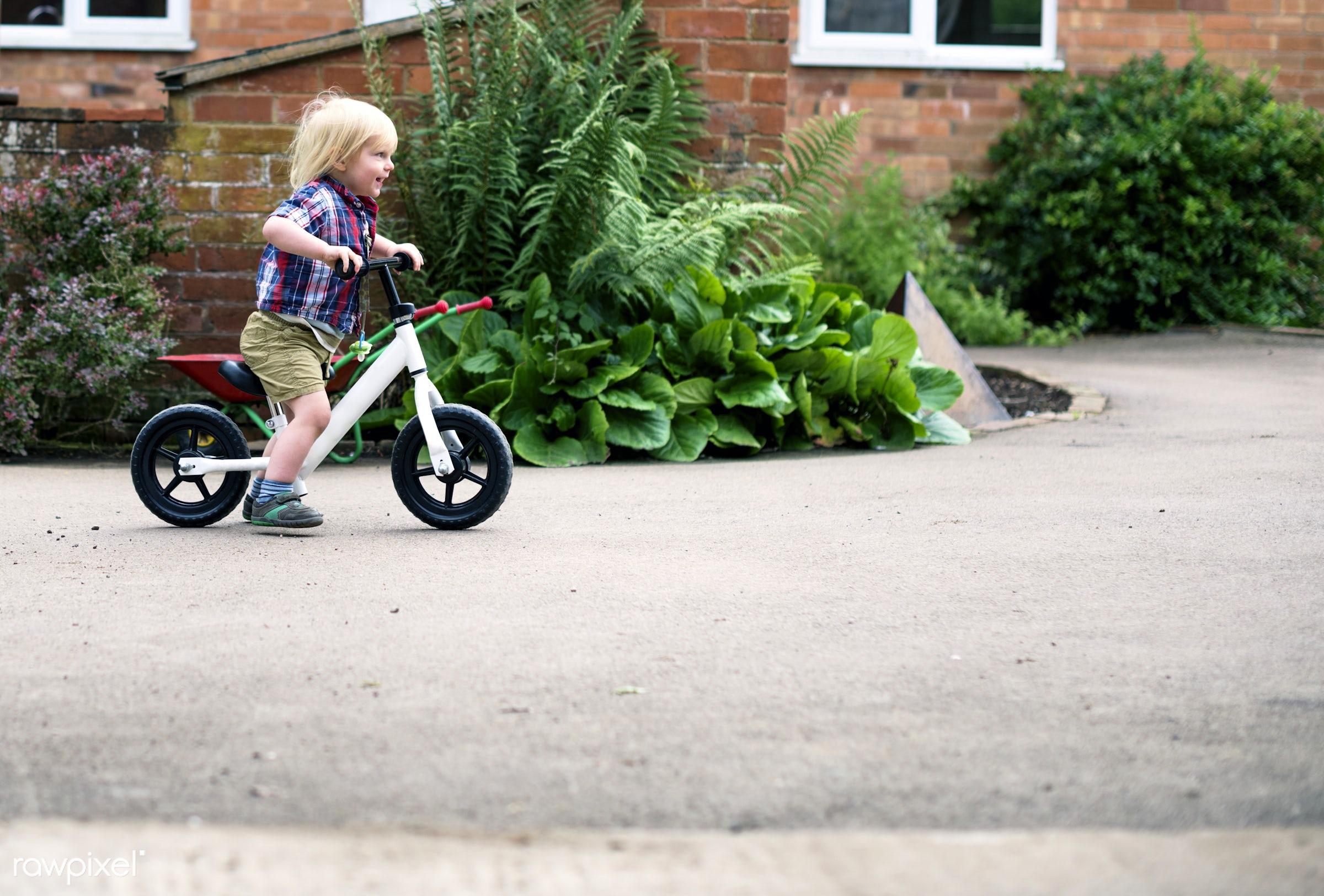 Kid in the garden - bike, activity, alone, bicycle, boy, child, childhood, children, development, garden, hobby, home, house...
