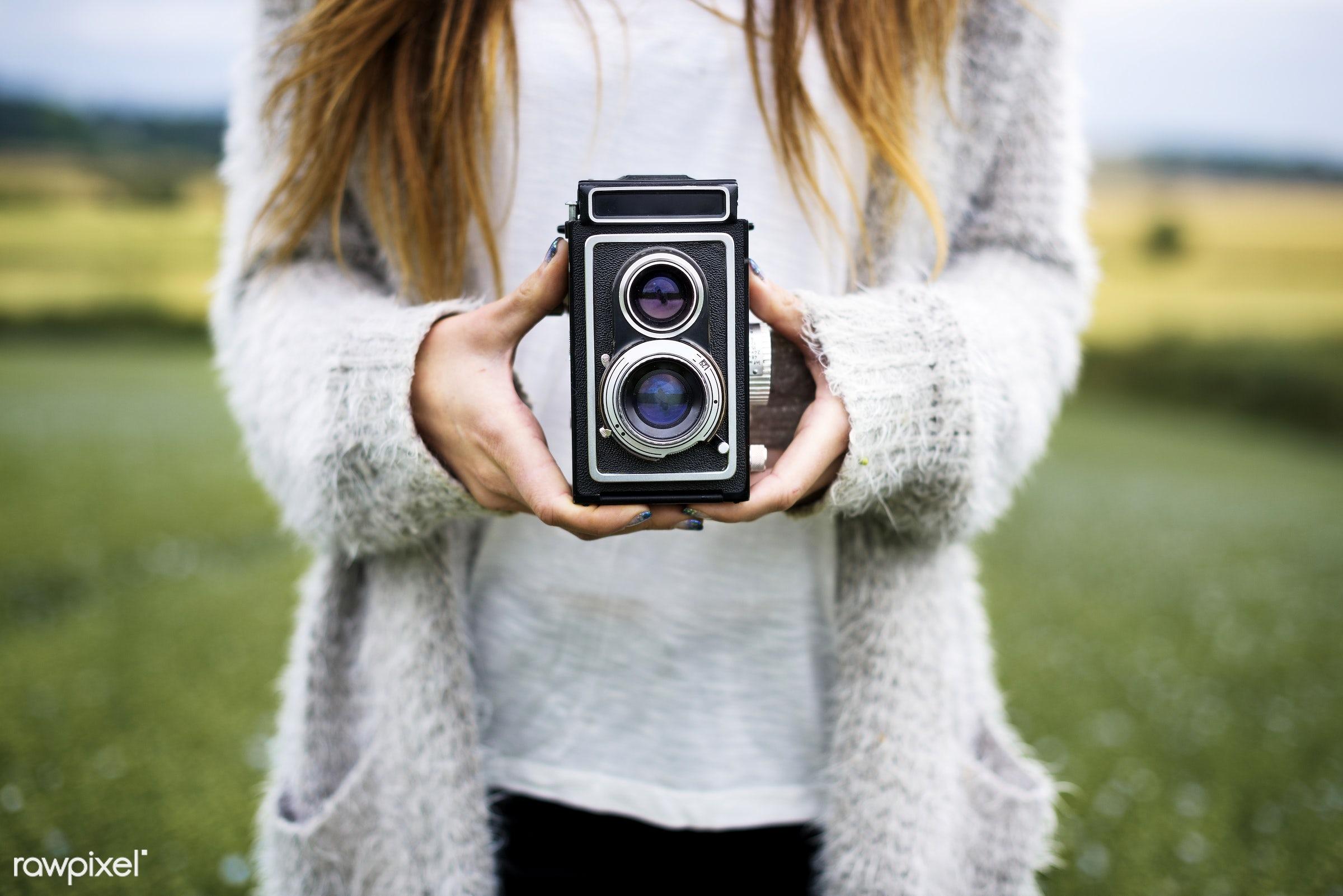 Woman holding retro film camera - alone, camera, classic, closeup, film camera, hands, holding, nature, one, outdoors, retro...