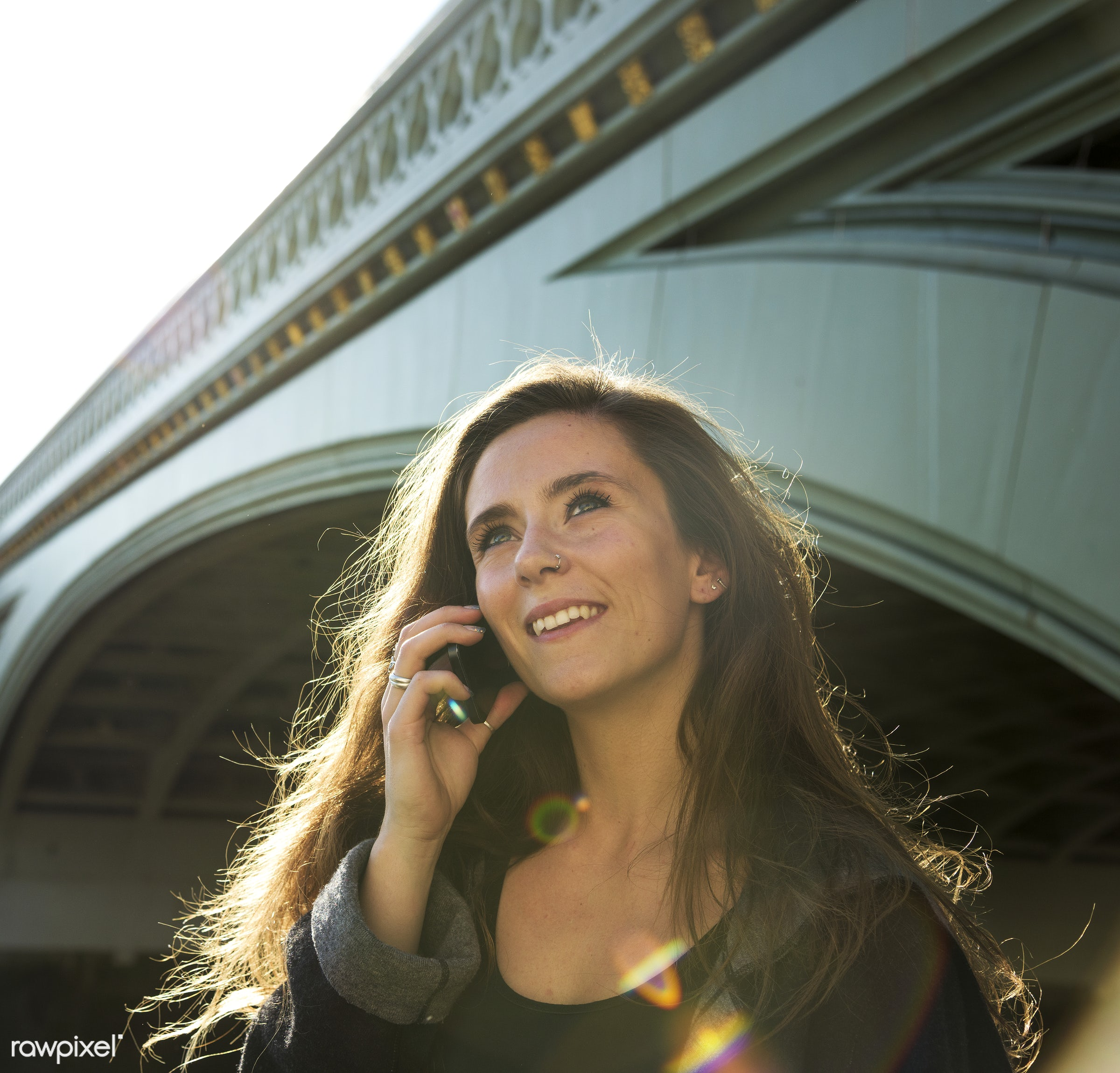 Beautiful woman on the phone - adult, architecture, bridge, building, call, calling, casual, cellphone, cellular, city,...