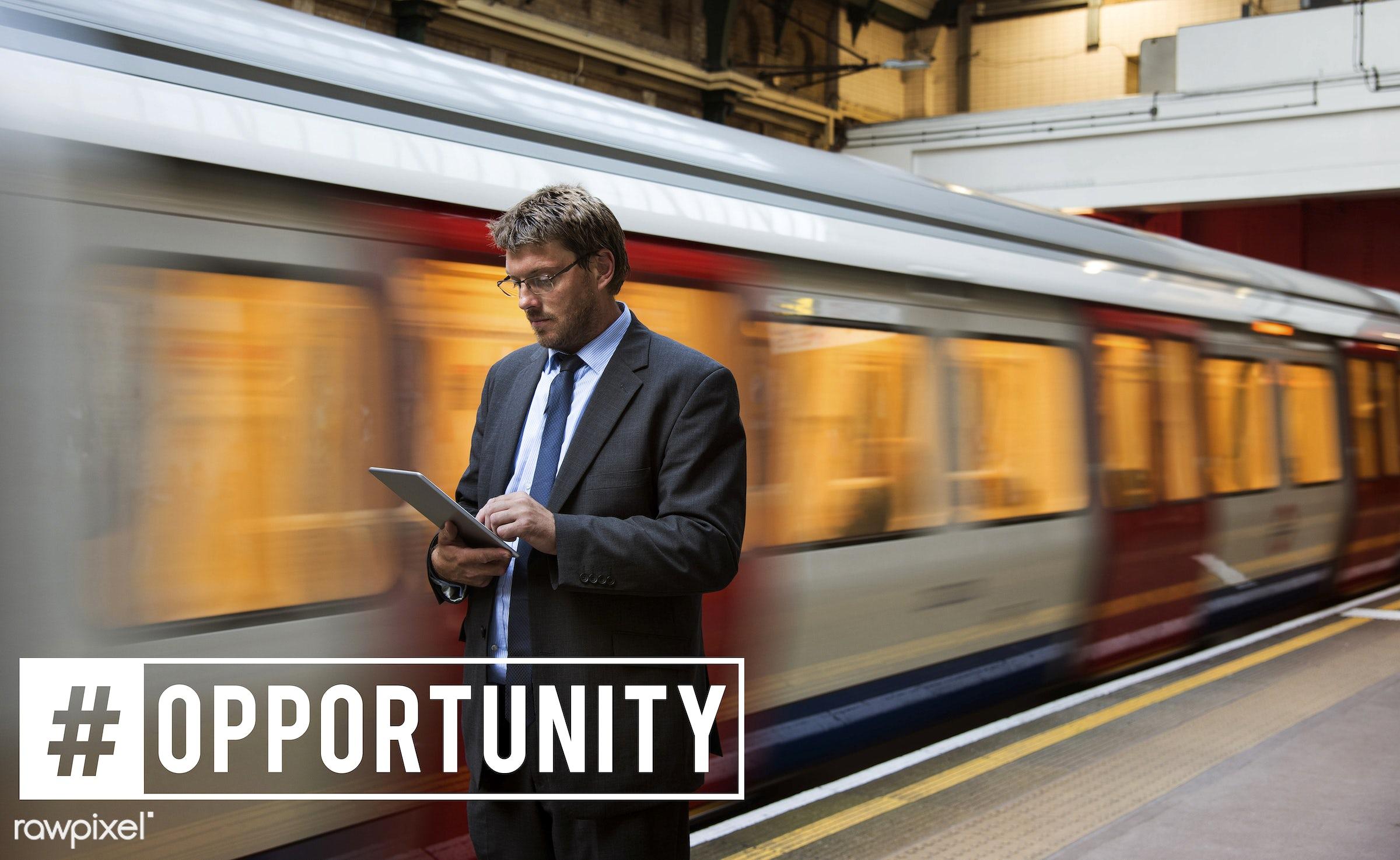 business, businessmen, device, digital, digital device, digital tablet, london, man, men, moving, subway, suit, suit and tie...