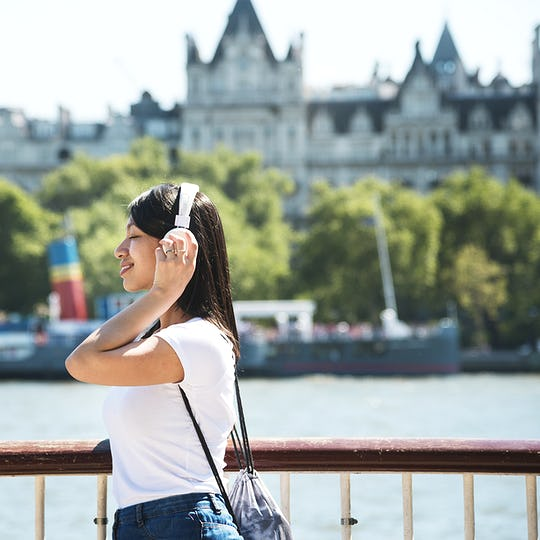 Beautiful asian woman listening to music