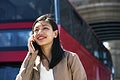 Cheerful woman making a call