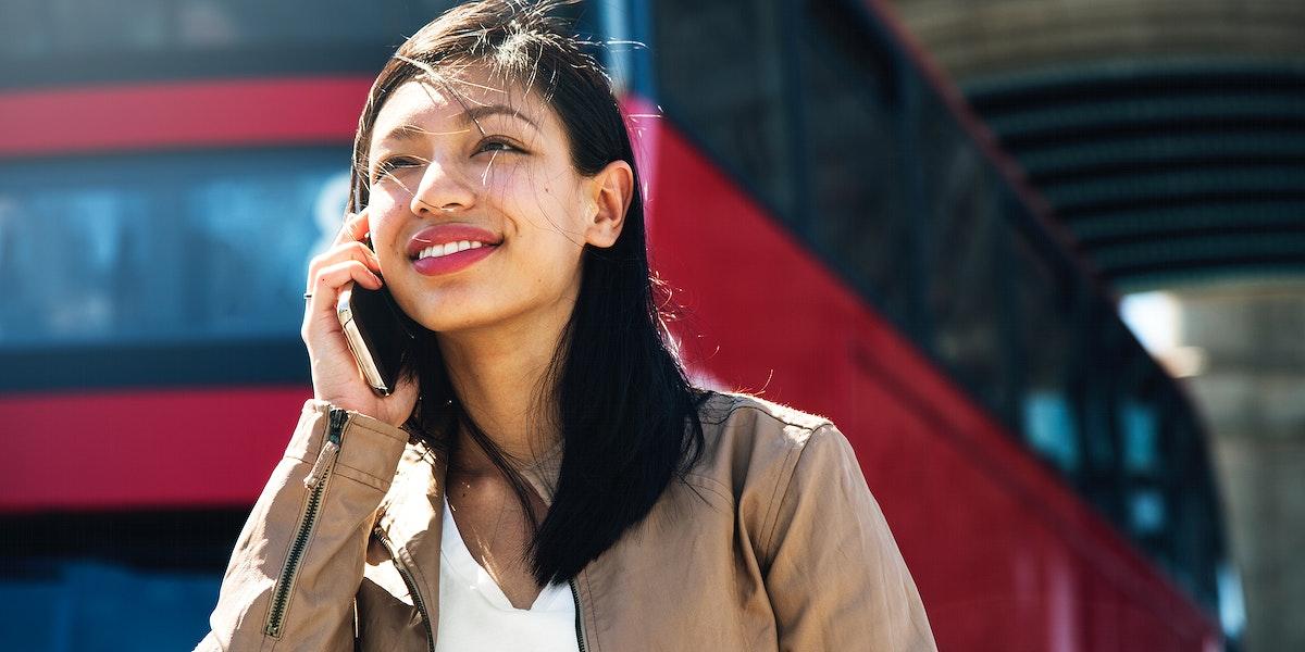 Beautiful asian woman on the phone
