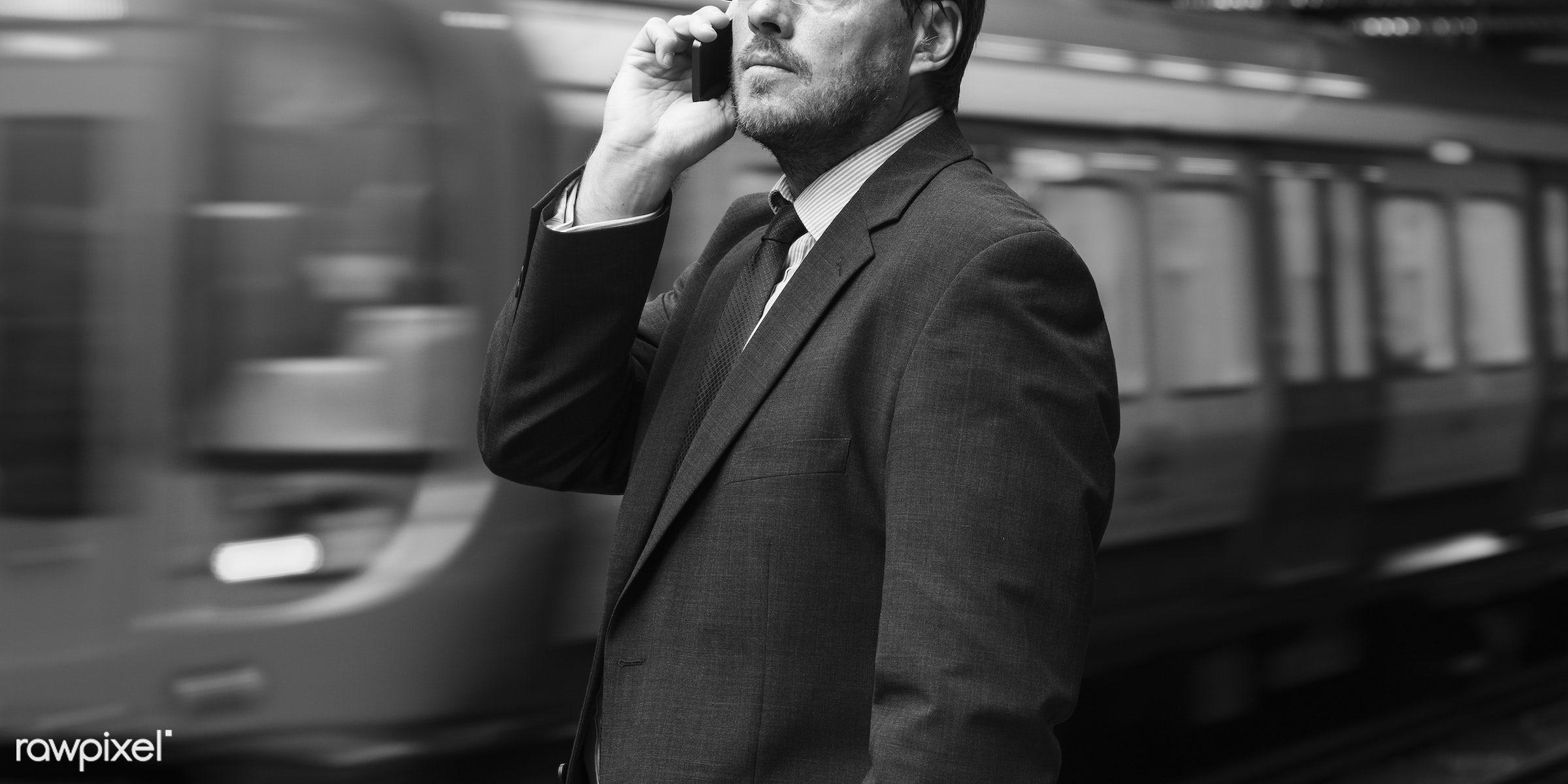 Businessman on train station - adult, aspirations, business, businessman, call, calling, communication, confidence,...