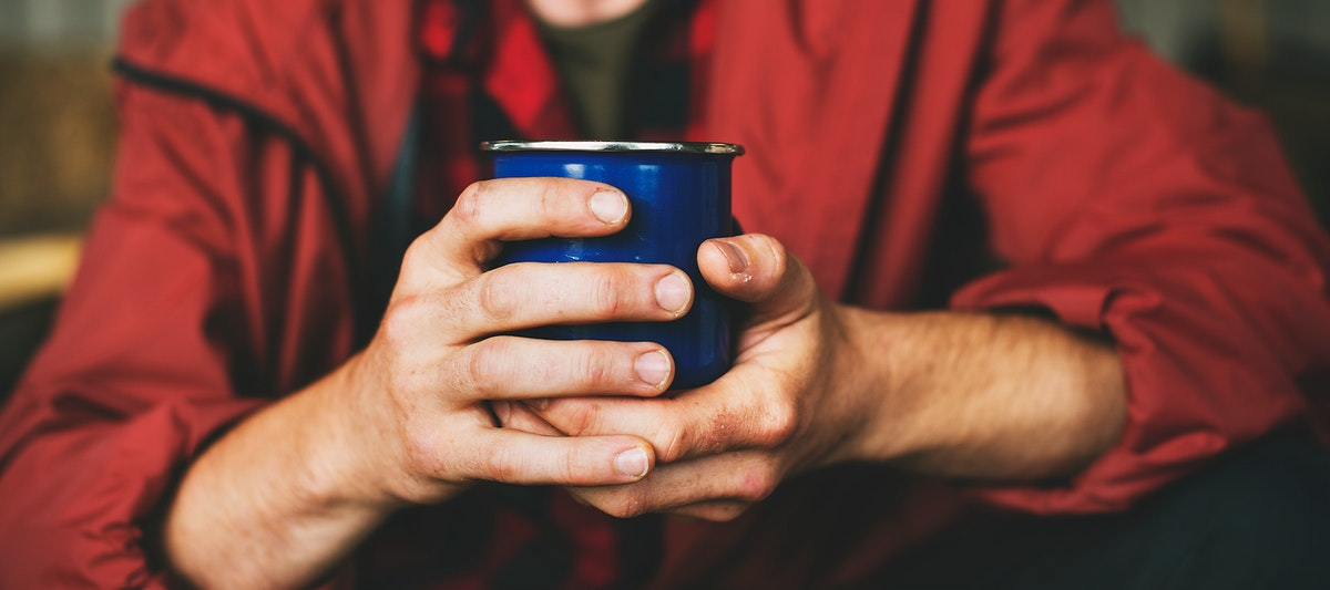 Closeup of hands holding coffee cup