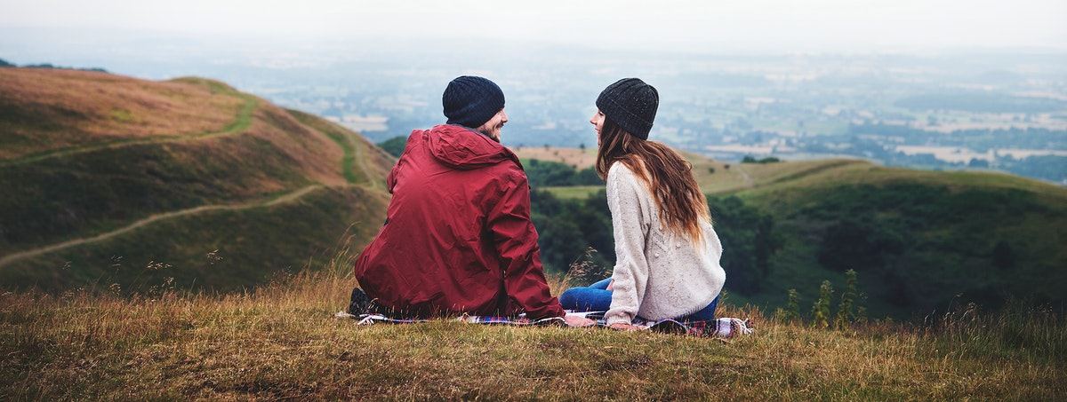 Couple sitting on hill