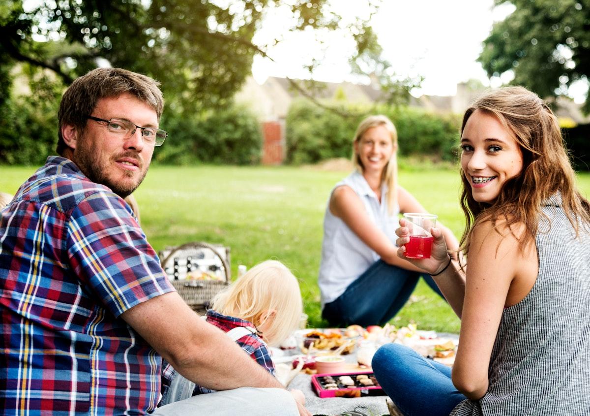 Happy family picnic in the park