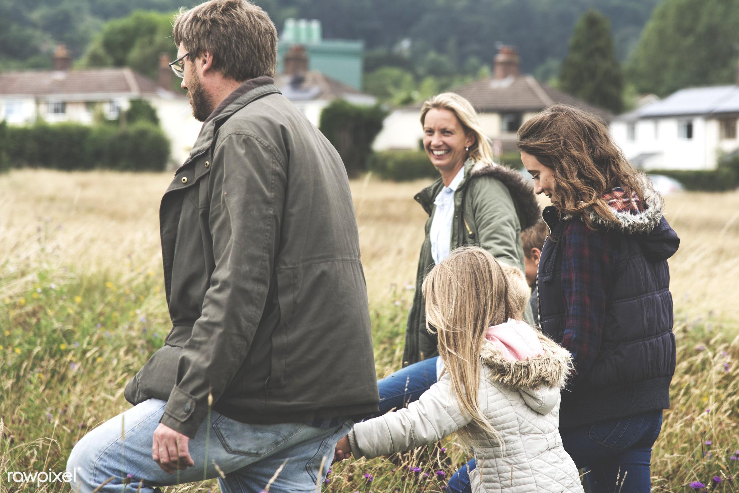 Happy family in the park - bonding, cheerful, children, enjoyment, family, father, field, fun, garden, generations, grass,...