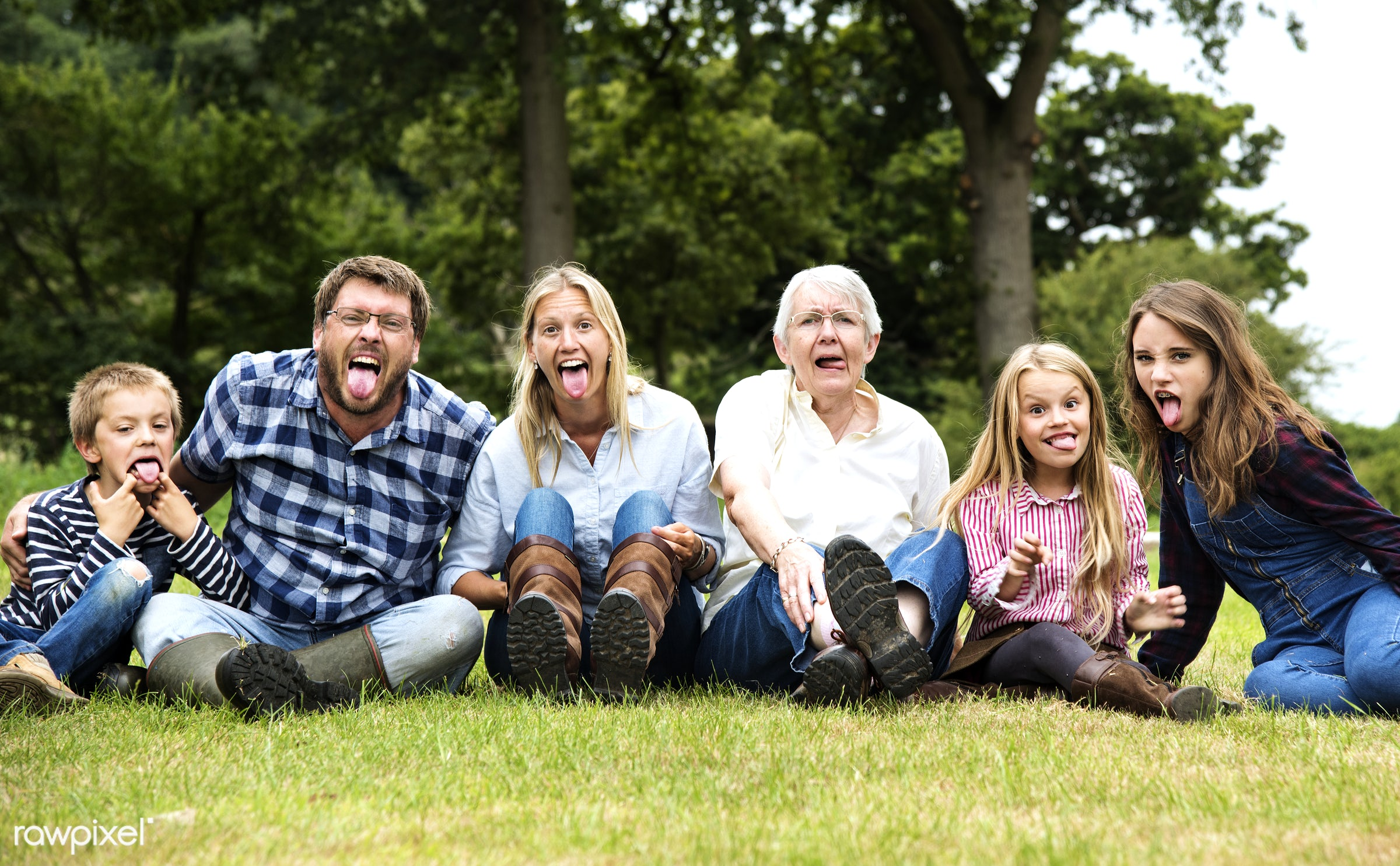 Happy family  - bonding, cheerful, children, enjoyment, family, father, field, fun, garden, generations, grass, happiness,...