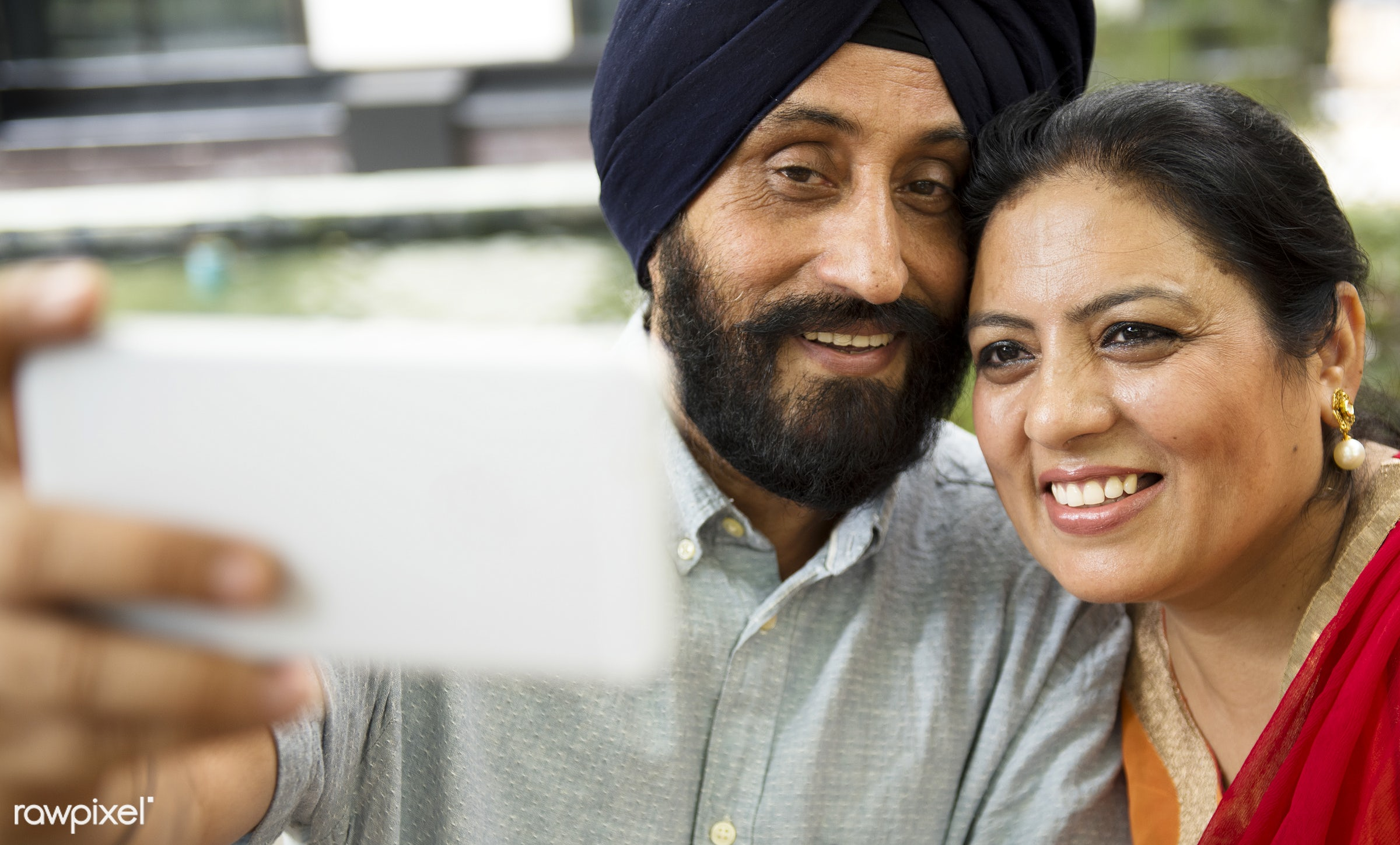 Loving senior Indian couple - activity, adult, asian, bonding, care, casual, cheerful, couple, day, device, digital,...