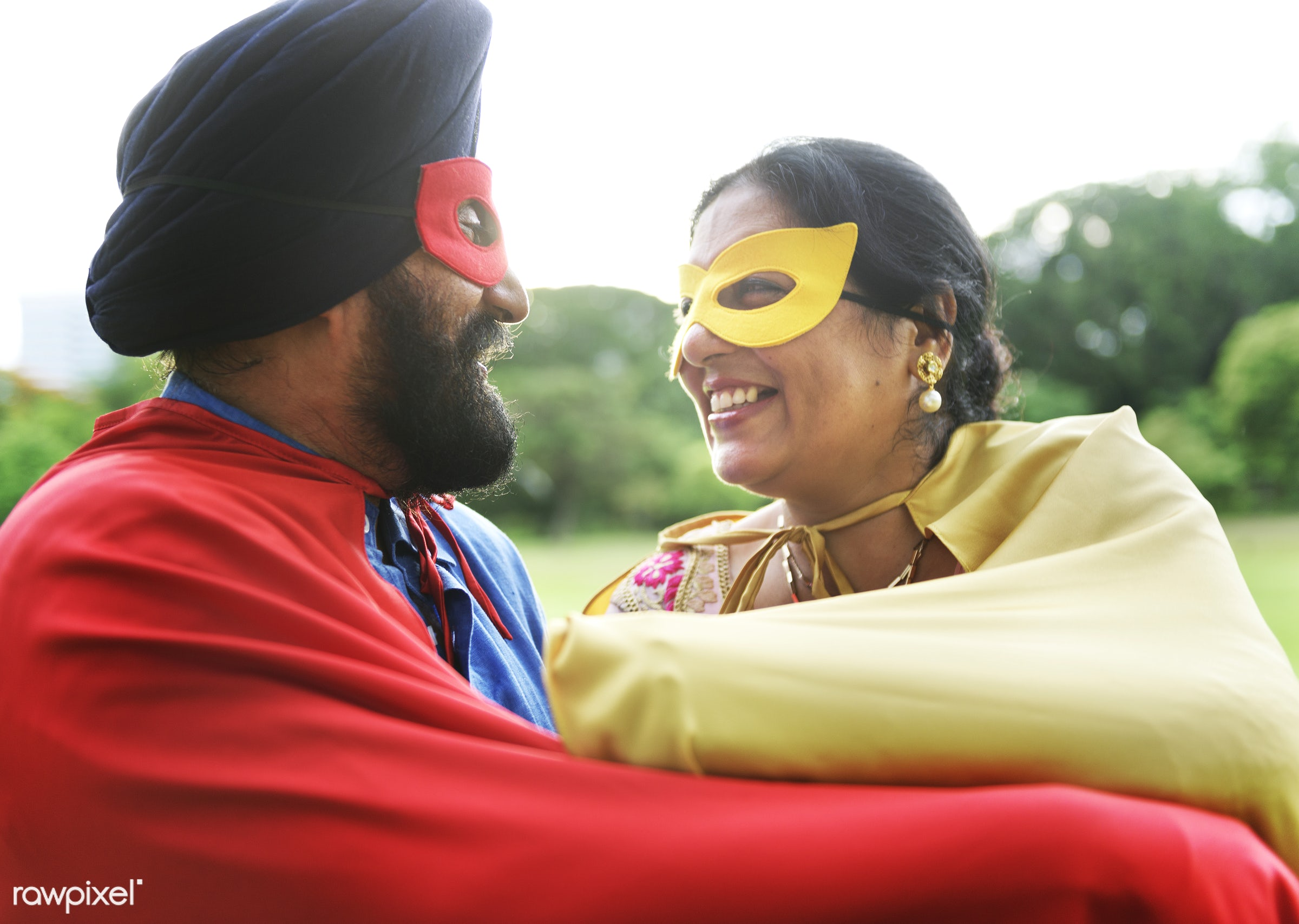 Loving senior Indian couple playing superheroes - activity, adult, asian, bonding, care, casual, cheerful, costume, couple,...