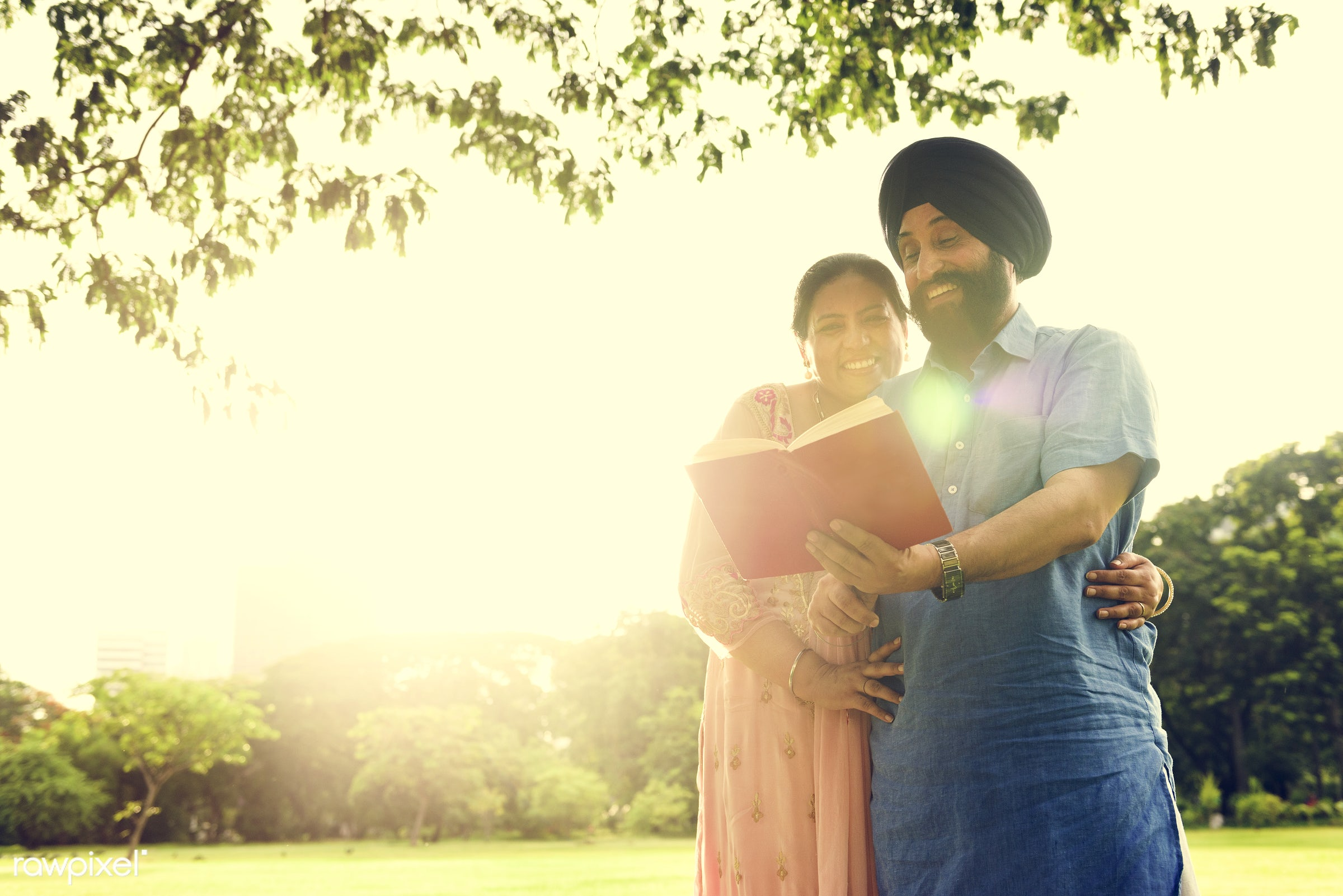Loving senior Indian couple - activity, adult, asian, bonding, book, care, casual, cheerful, couple, day, ethnicity, family...