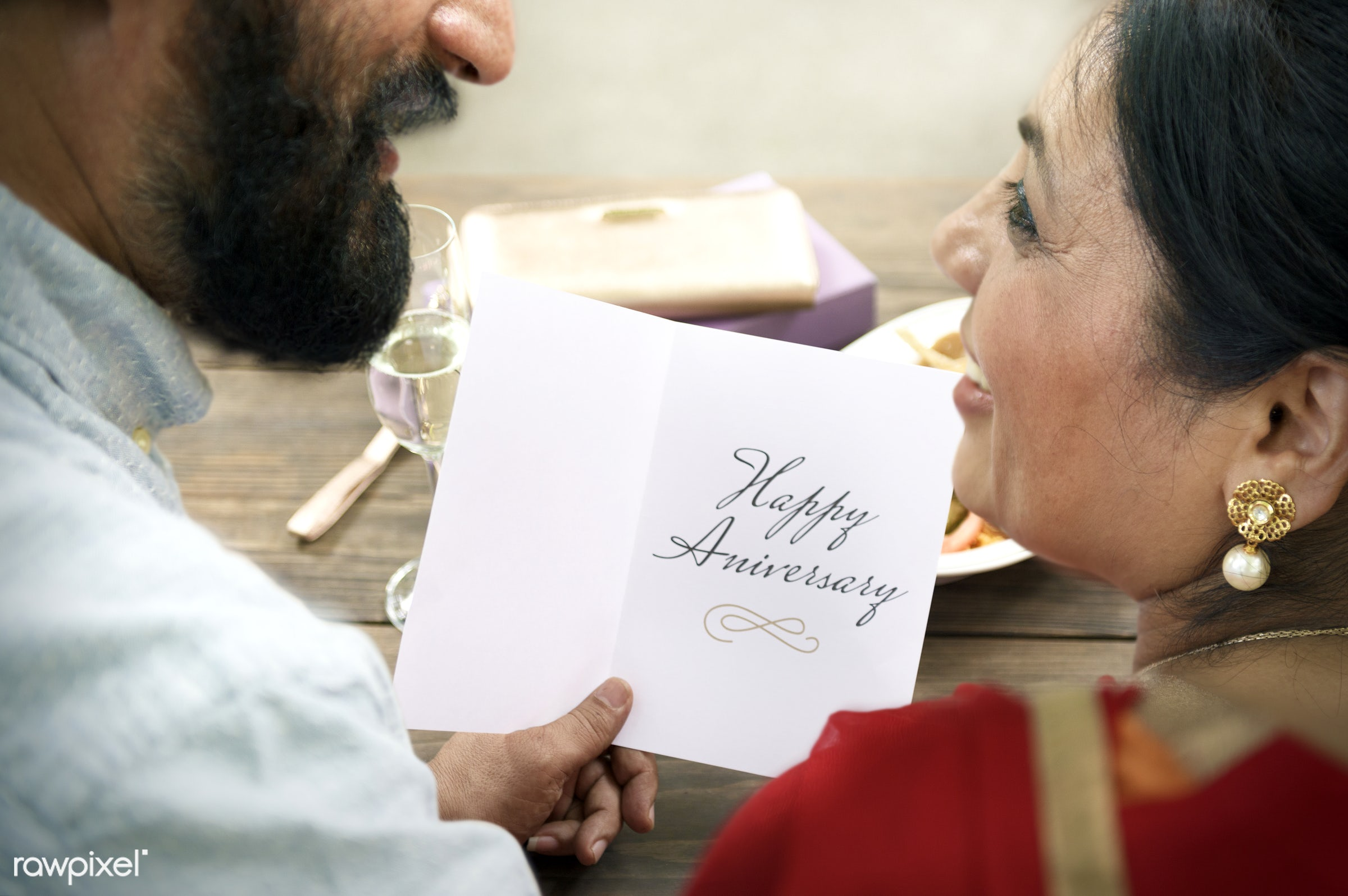 Senior Indian couple - anniversary, care, celebrating, celebration, champagne, cheerful, communication, congratulations,...