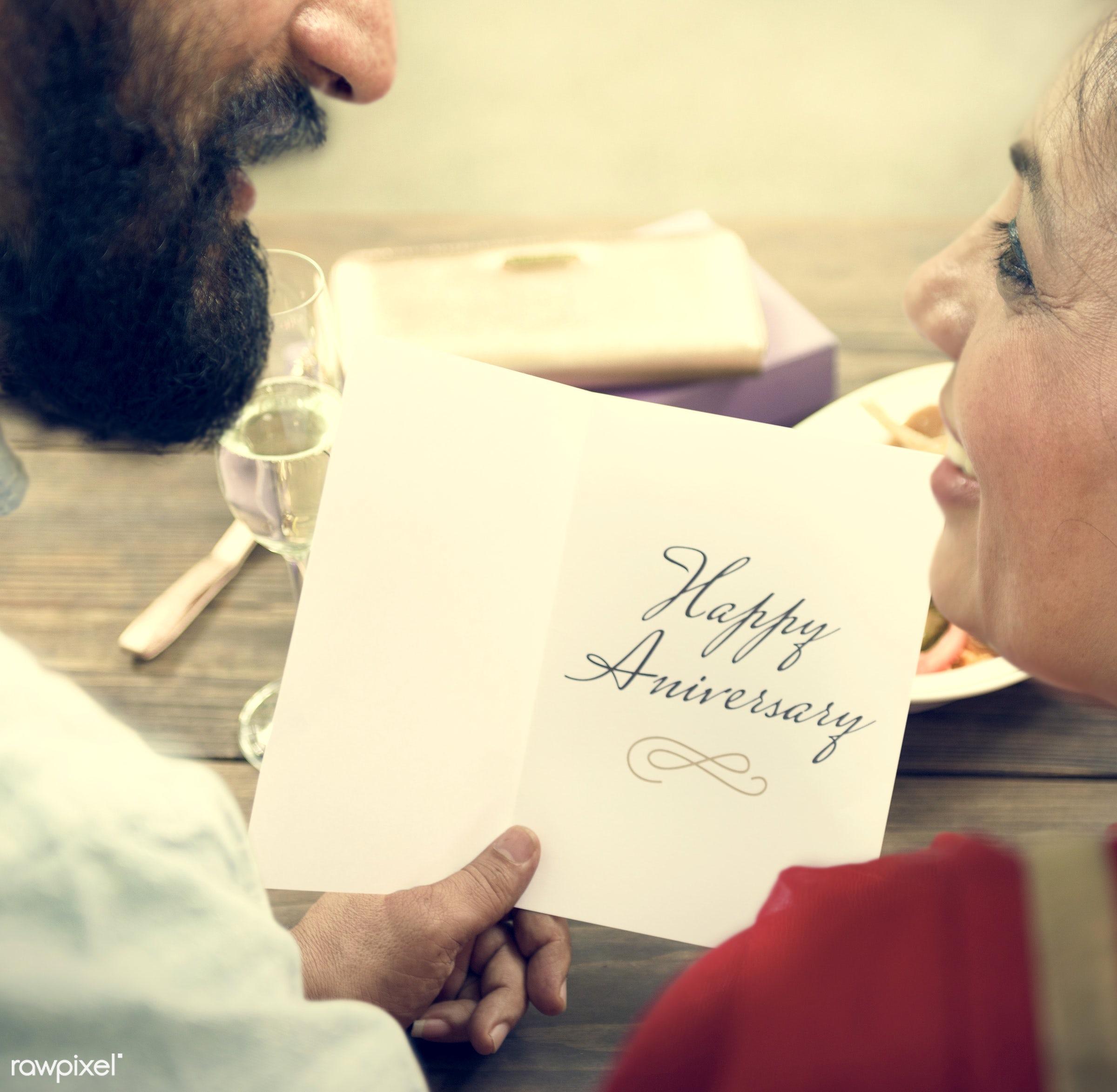Loving senior Indian couple - anniversary, care, celebrating, celebration, champagne, cheerful, communication,...