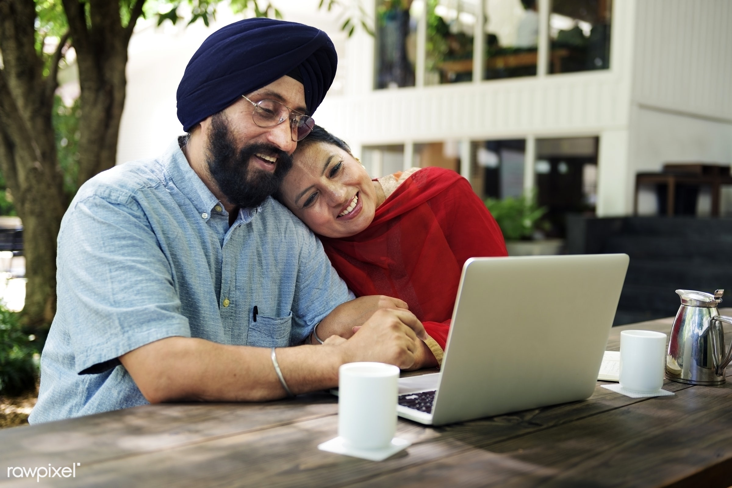 Indian Couple Using Device Concept - adult, care, cheerful, coffee, communication, connection, couple, credit, cup, device,...