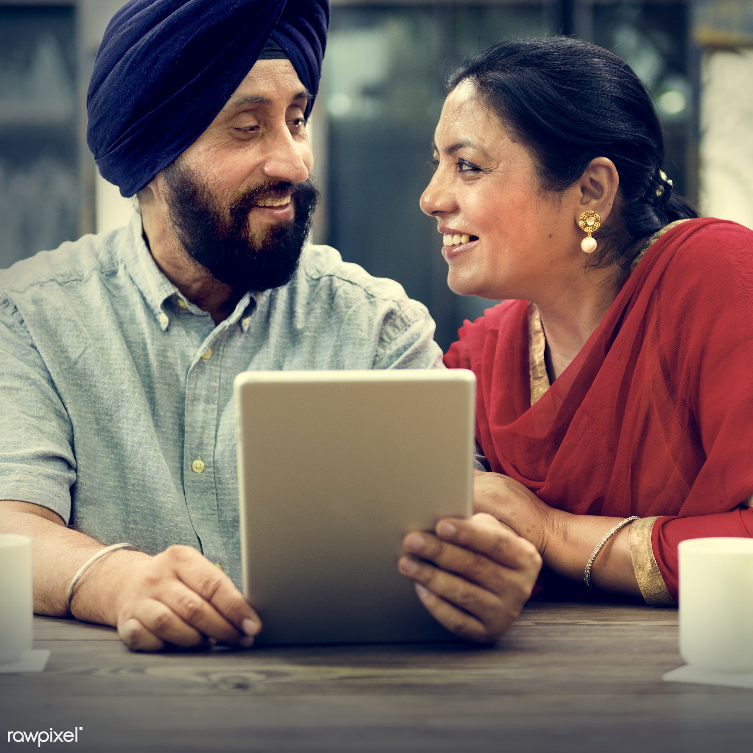 Indian Couple Using Device Concept - adult, browsing, care, cheerful, communication, connection, couple, cup, device,...
