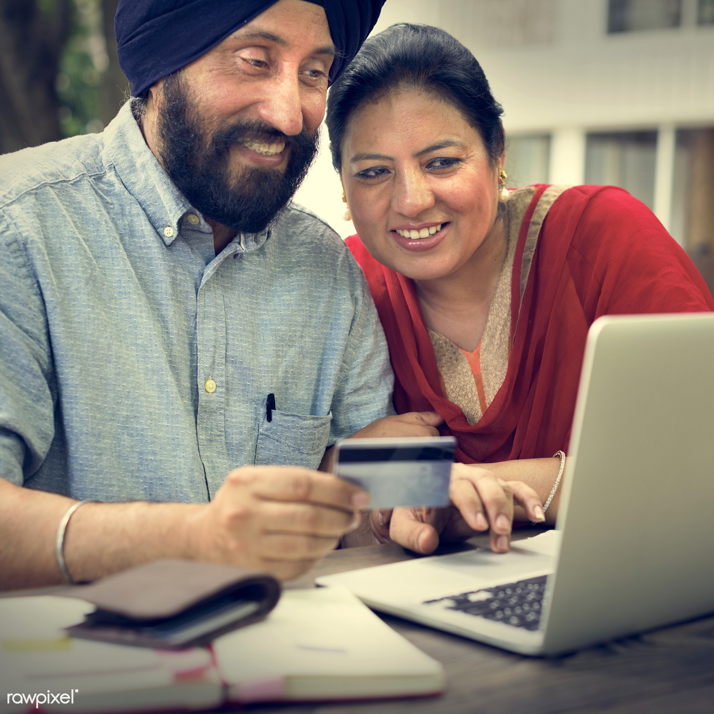 Indian Couple Using Device Concept - adult, browsing, card, care, cheerful, communication, connection, couple, credit, cup,...