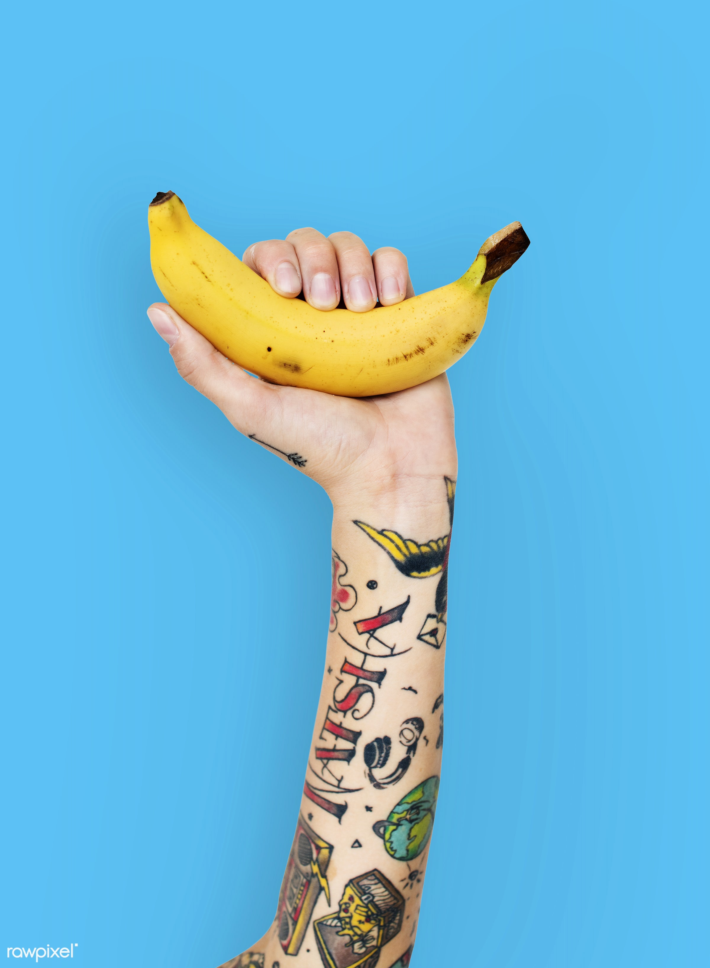 Tattoo covered arms holding a banana - tattoo, vitamin, adult, alternative, art, attractive, background, banana, blue, body...