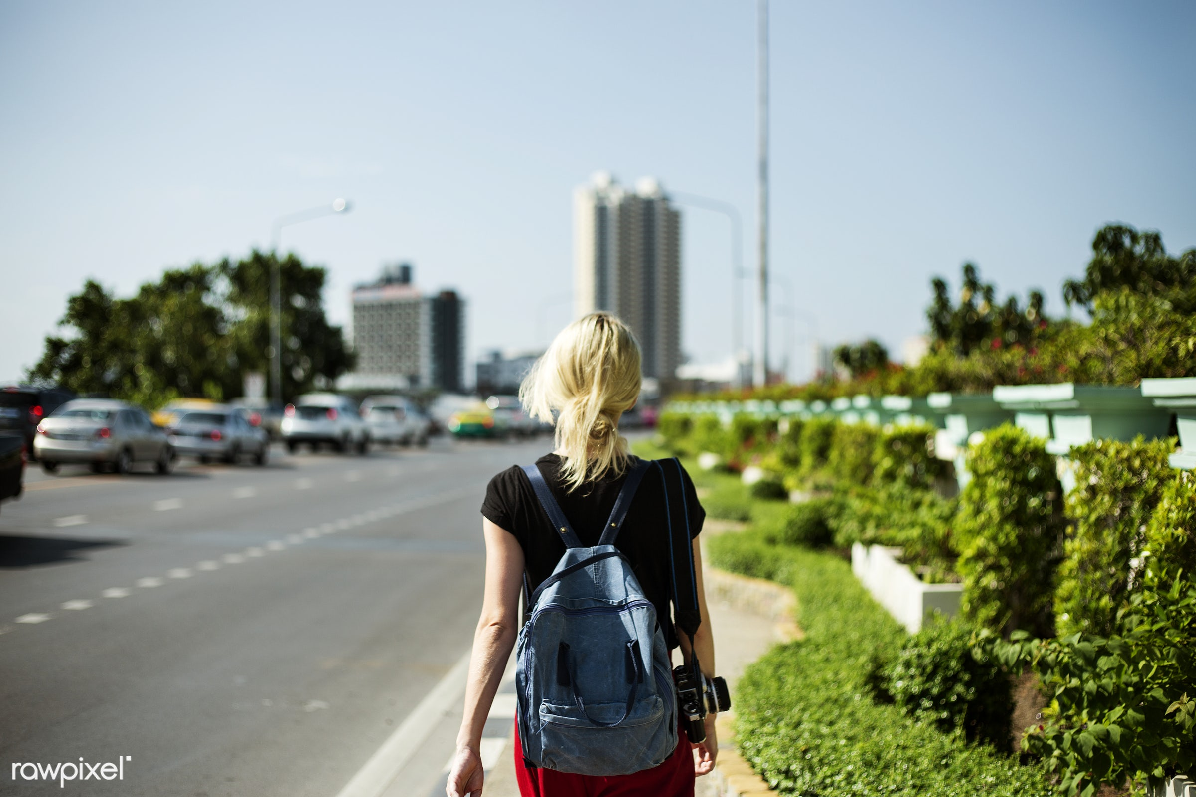 alone, back, black tee, blonde, camera, caucasian, female, messy hair, one, outdoors, pathway, person, road, solo, street,...