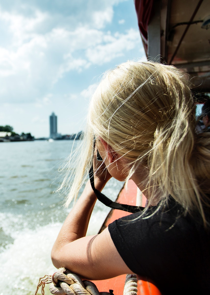 Female photographer riding a boat