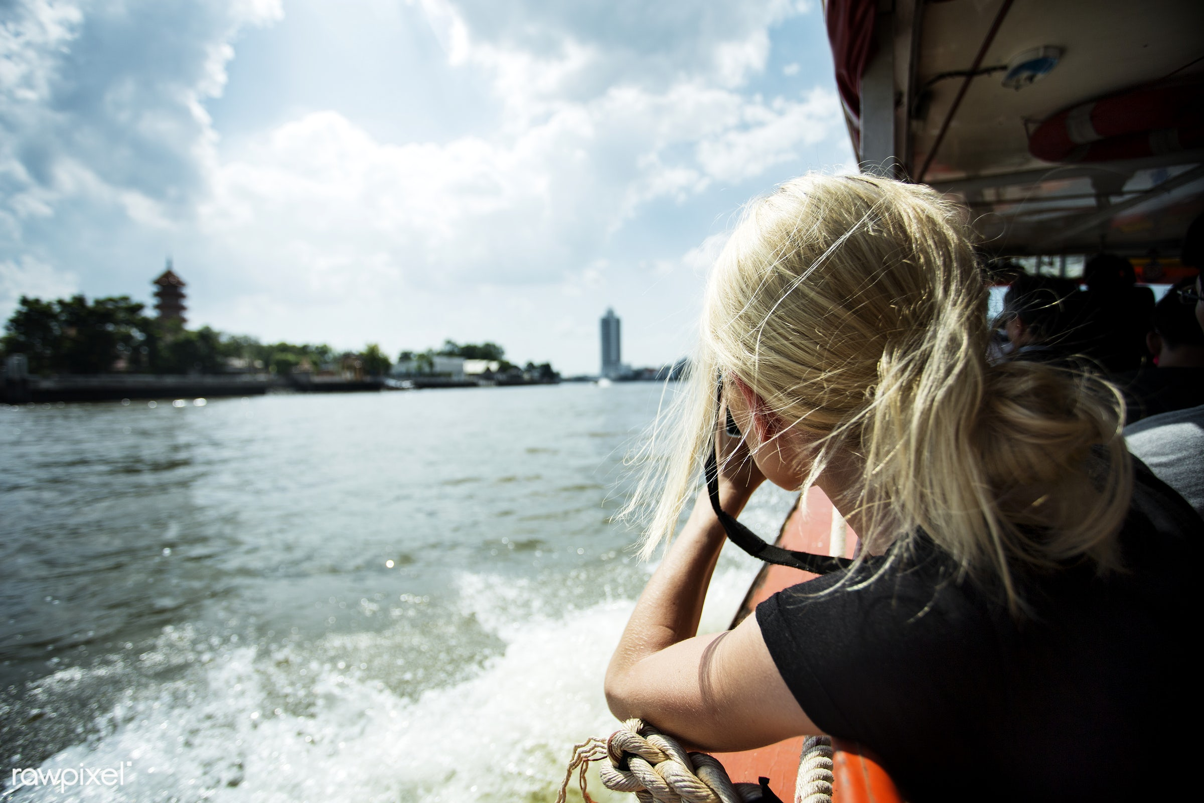 alone, back, black tee, blonde, boat, camera, caucasian, female, messy hair, one, outdoors, person, portrait, river boat,...