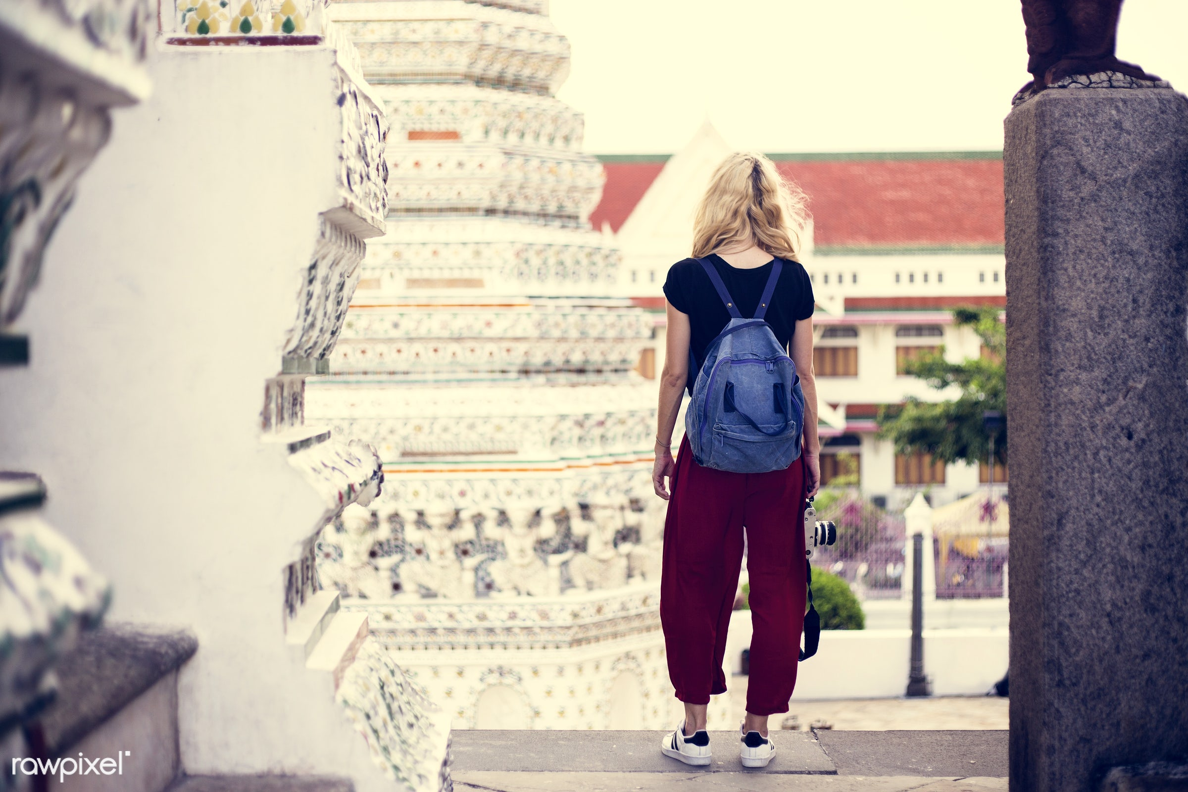 adult, alone, back, backpack, black, black tee, blonde, camera, caucasian, explore, female, hand, holding, one, outdoors,...