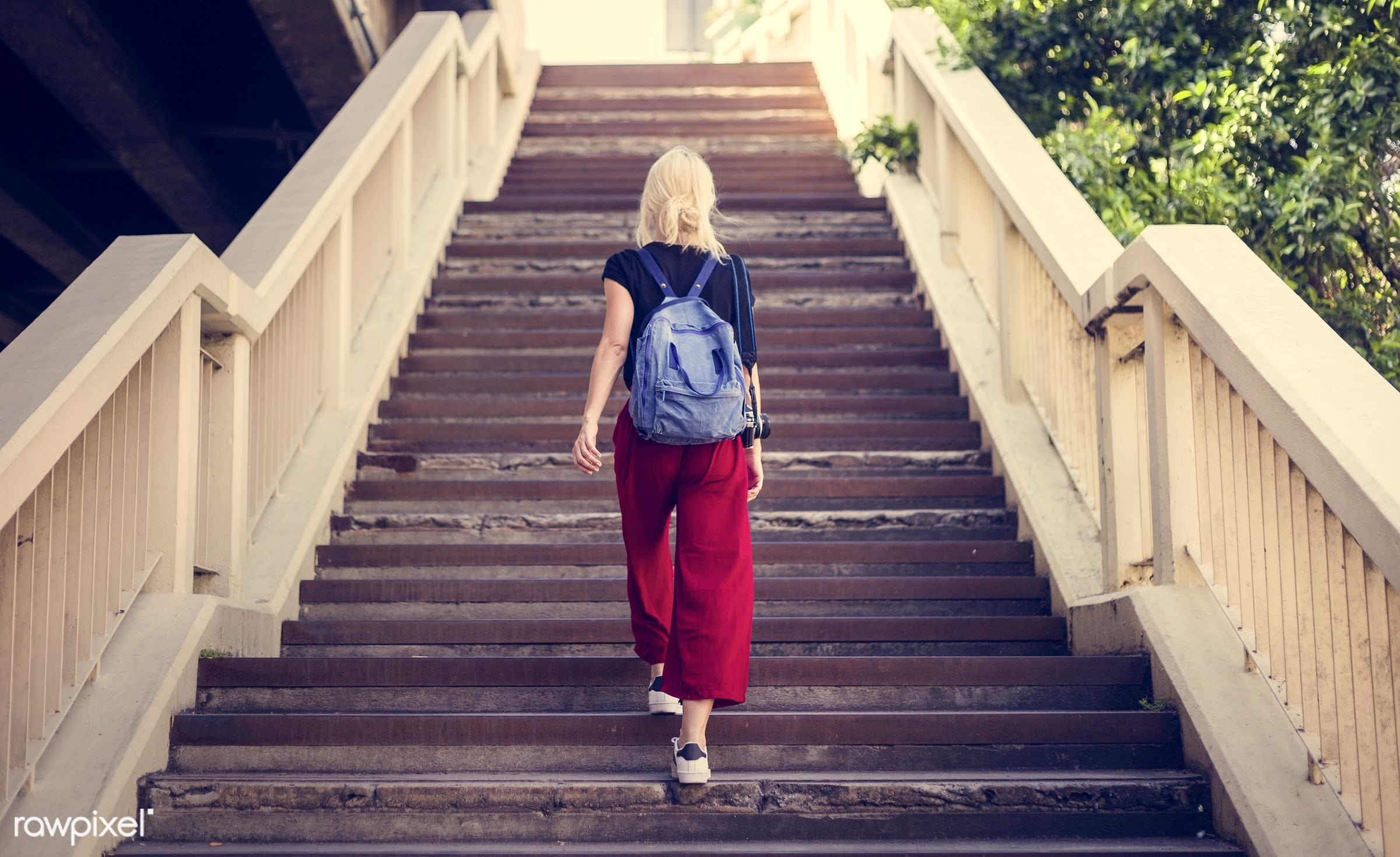 alone, back, backpack, black tee, blonde, camera, explore, female, one, outdoors, people, person, solo, stairs, sweden,...