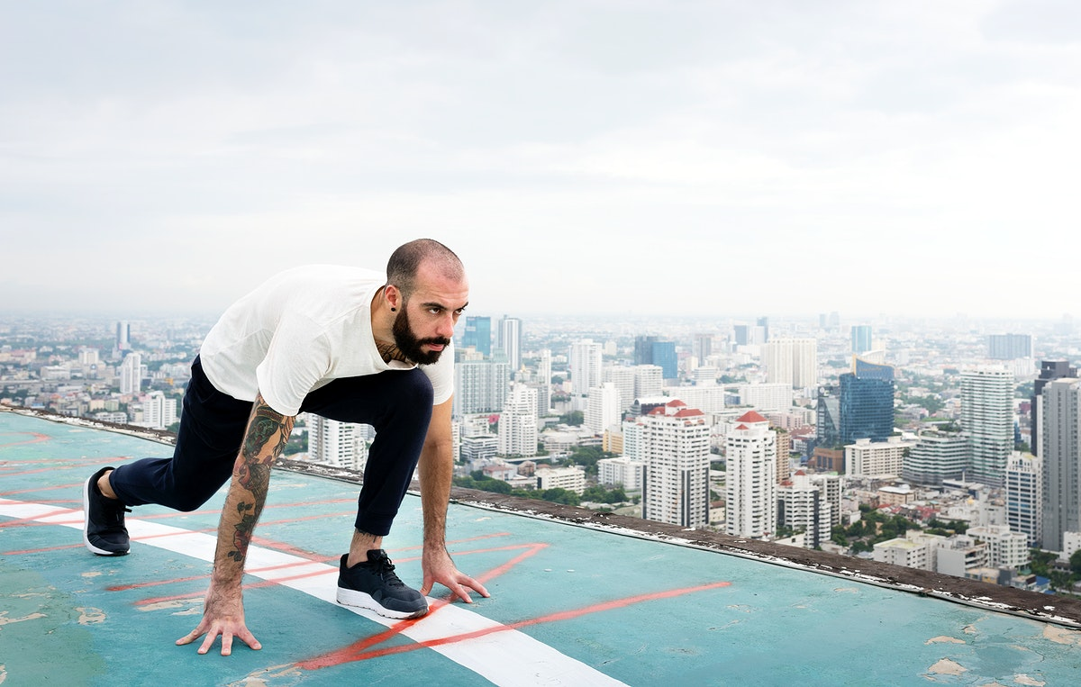 Man practicing yoga on a rooftop